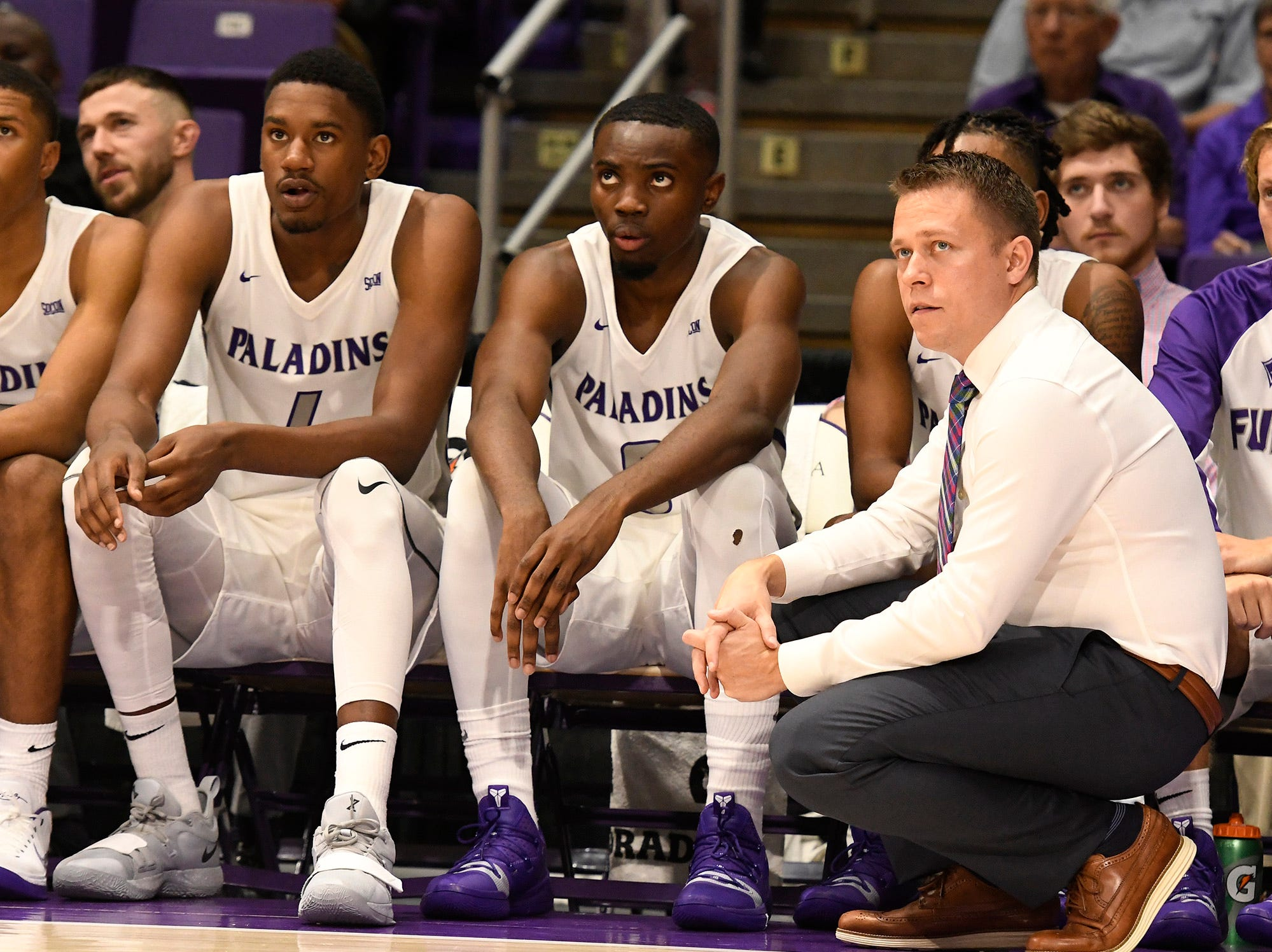 Furman head basketball coach Bob Richey, right, surveys action against Bob Jones Tuesday, November 6, 2018, at Timmons Arena.