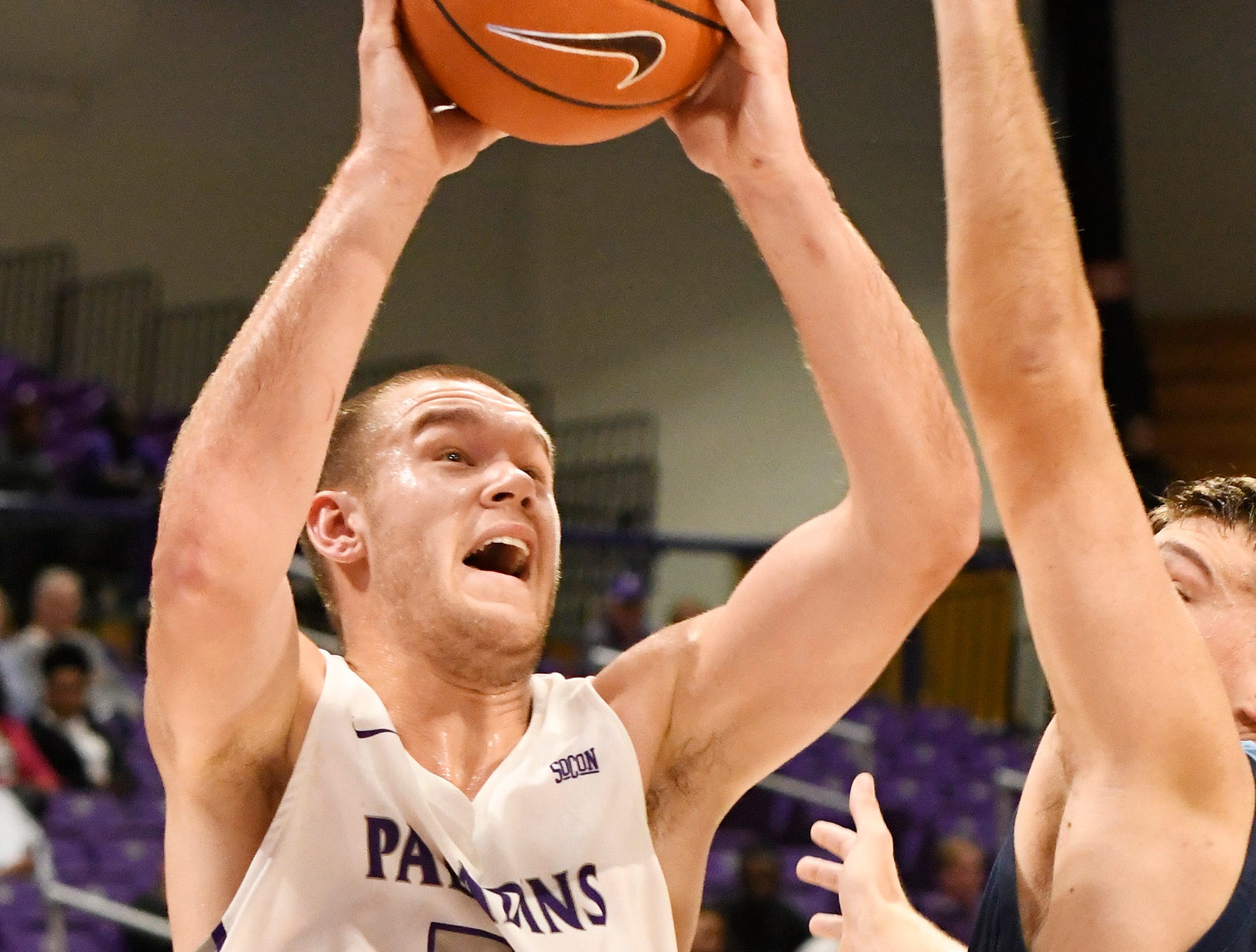 Furman's Matt Rafferty (32) goes to the hoop against Bob Jones Tuesday, November 6, 2018, at Timmons Arena.