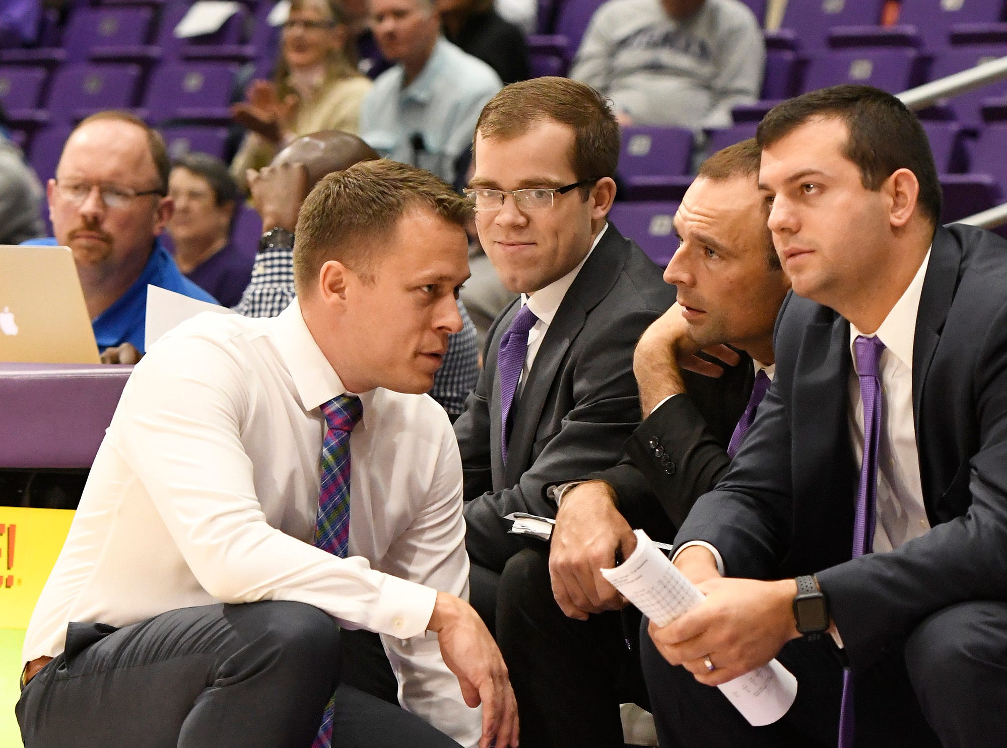 Furman head basketball coach Bob Richey speaks with his assistant coaches while facing Bob Jones Tuesday, November 6, 2018, at Timmons Arena.