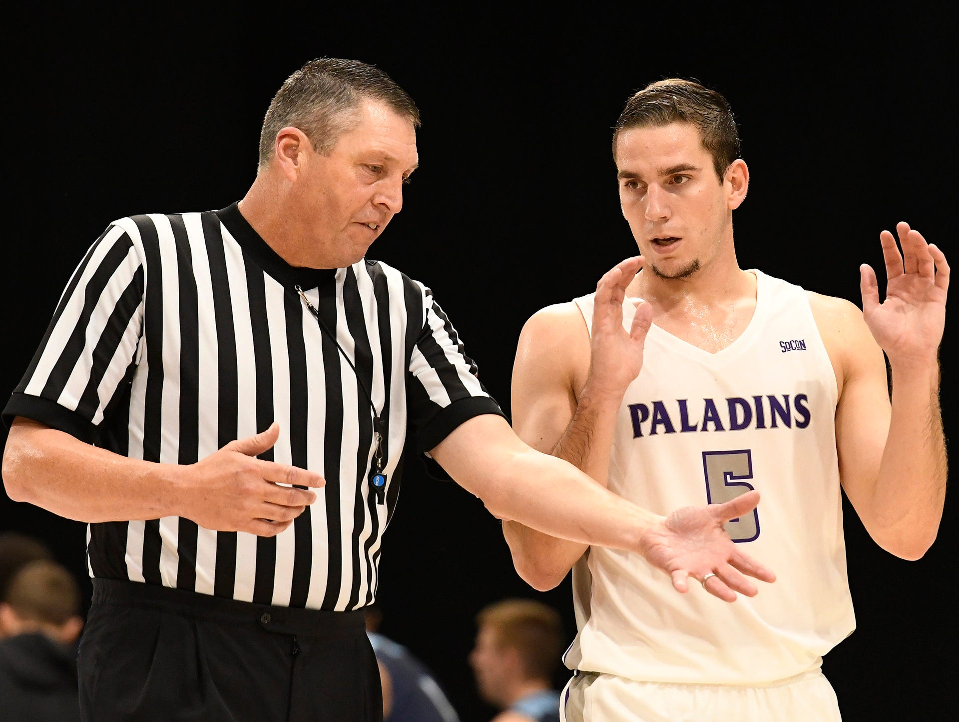 Furman's Andrew Brown (5) discusses a call with the referee while facing Bob Jones Tuesday, November 6, 2018, at Timmons Arena.
