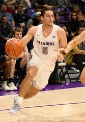 Furman's Andrew Brown (5) charges the basket against Bob Jones Tuesday, November 6, 2018, at Timmons Arena.