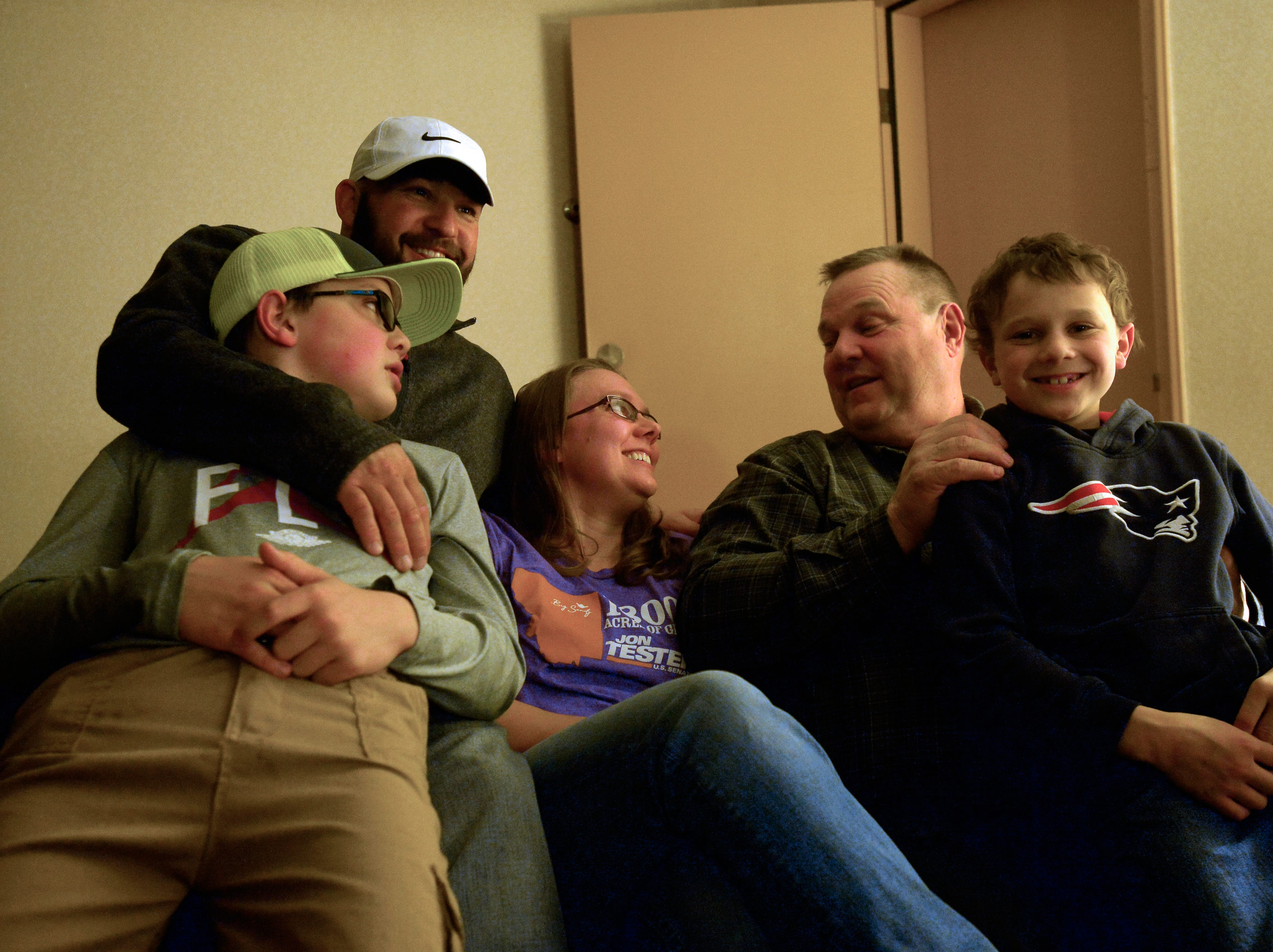Jon Tester sits with his daughter and grandchildren in a room at the Holiday Inn in Great Falls on Tuesday night as they wait for election night results.