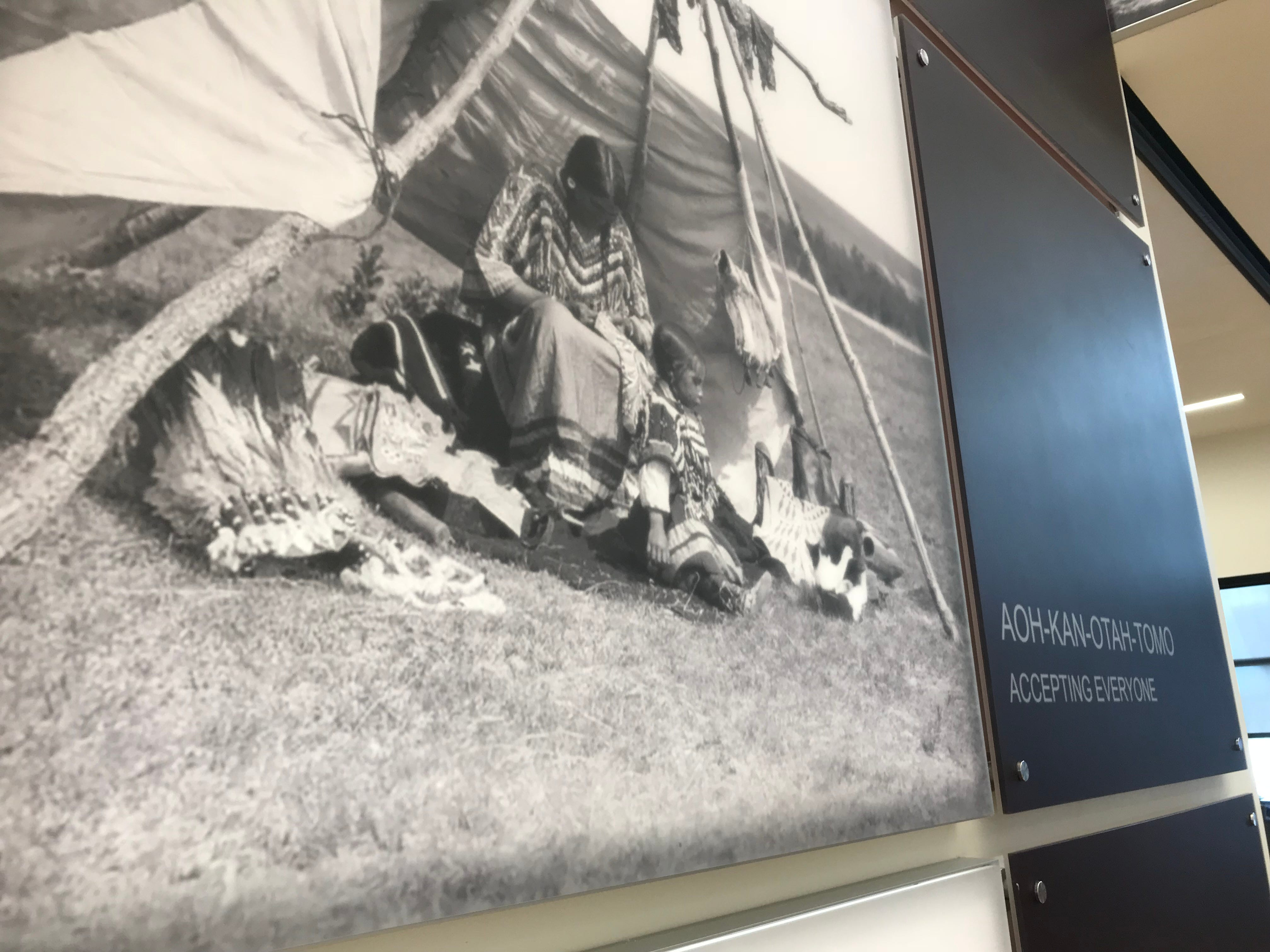 Photos and Blackfeet phrases are used in the decor of the new Blackfeet Community College building named Oahtkwii Piiksakii Iikohkon-Yellow Bird Woman Lodge in honor of Elouise Cobell, a Blackfeet tribal elder, banker and rancher and Presidential Medal of Freedom winner.