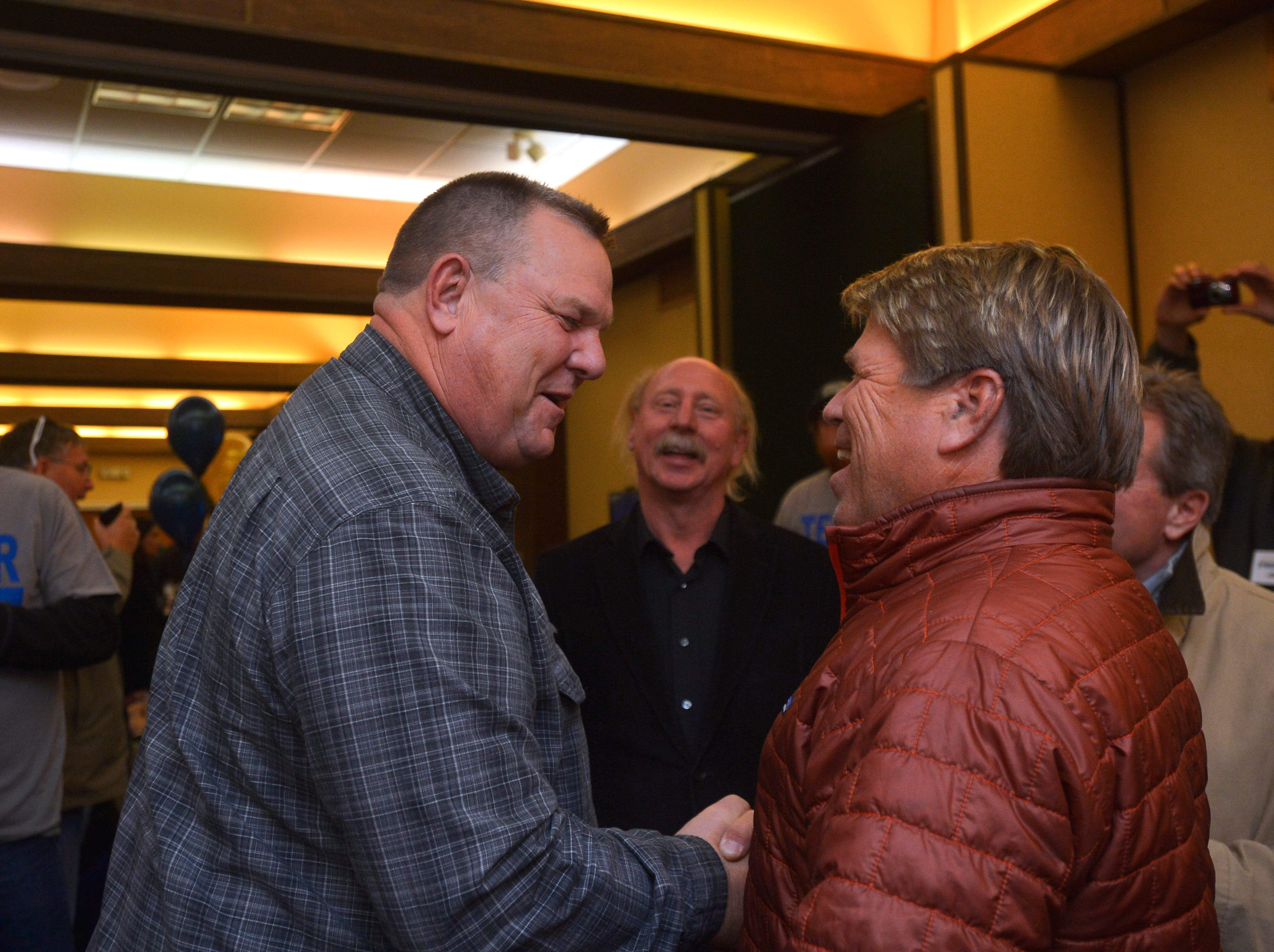 Senator Jon Tester mingles with supporters during his election night party at the Holiday Inn in Great Falls on Tuesday night.