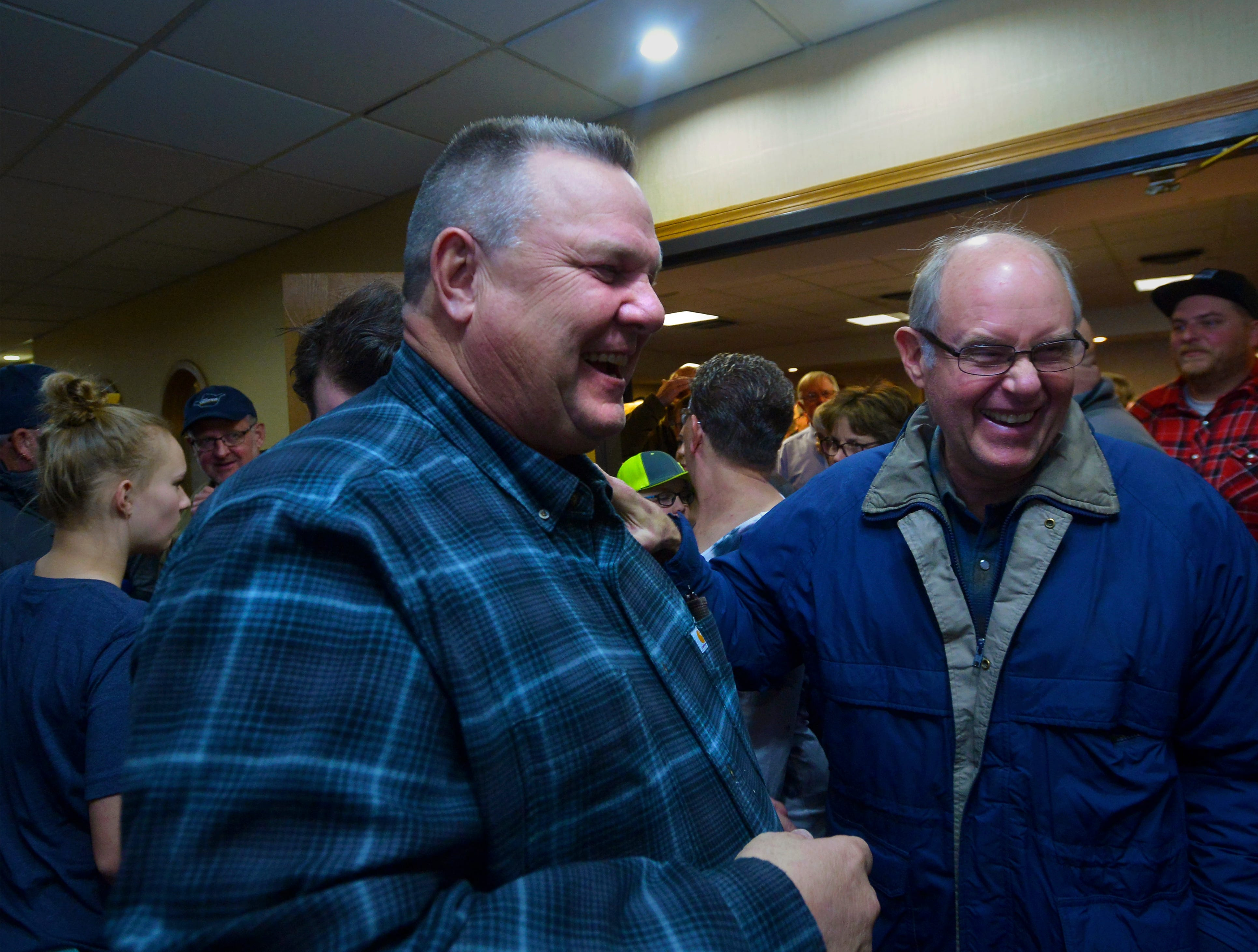 Sen. Jon Tester jokes with supporters after giving his victory speech at the Holiday Inn in Great Falls, Wednesday.