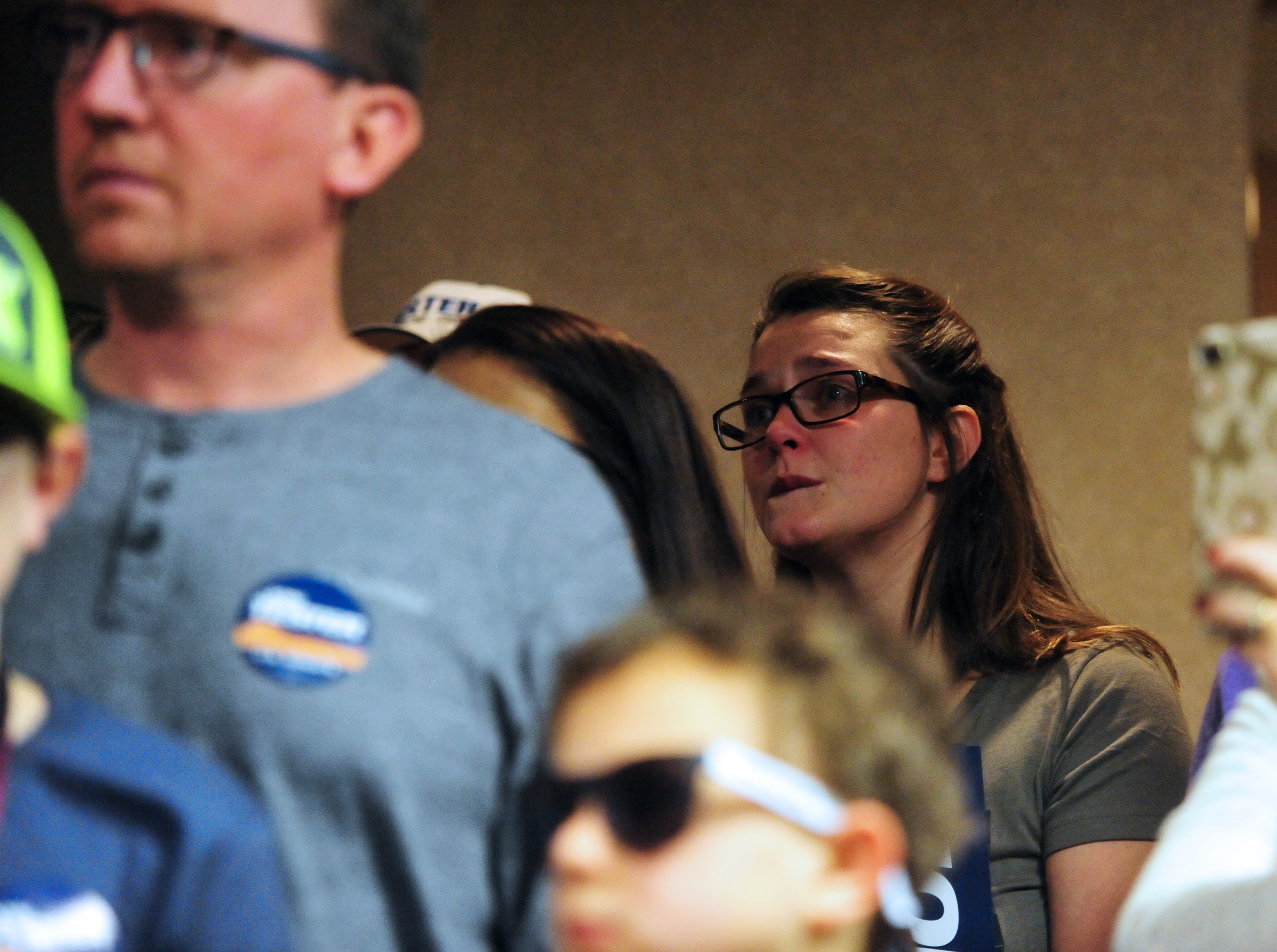 Sen. Jon Tester's campaign staff looks on as he delivers a victory speech on Wednesday morning at the Holiday Inn in Great Falls.