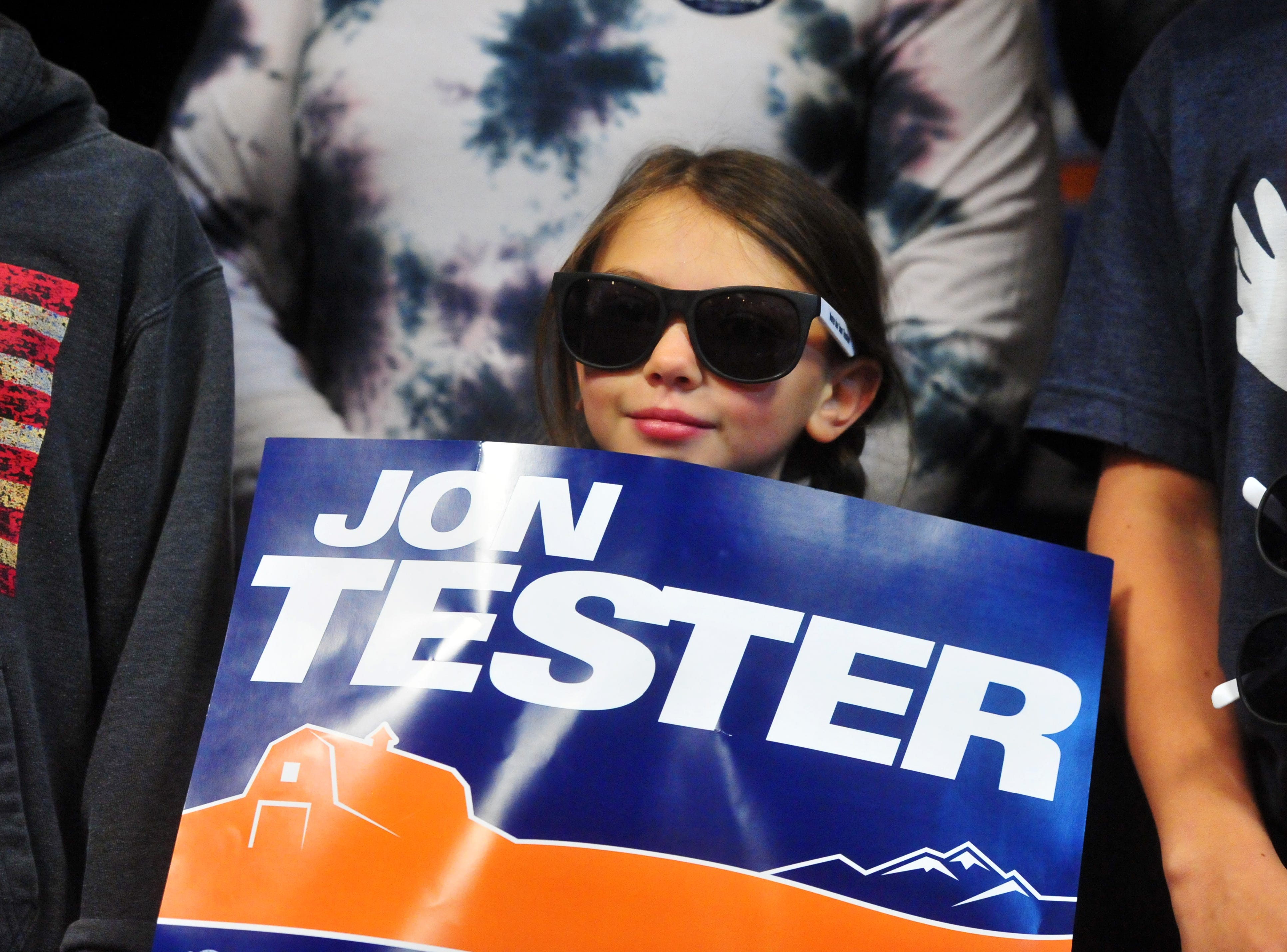 Senator Jon Tester's granddaughter, Abby Wall, holds up her grandfather's campaign sign during his victory rally on Wednesday morning at the Holiday Inn in Great Falls.