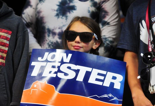 Sen. Jon Tester's granddaughter, Abby Wall, holds up his campaign sign during his victory rally on Wednesday morning at the Holiday Inn in Great Falls.