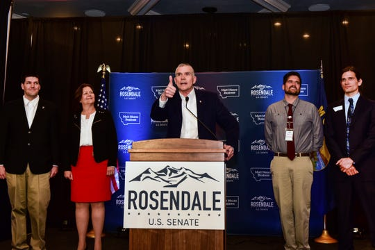 Senate Republican candidate Matt Rosendale greet supporters at the Delta Hotel along with his family from left Matthew, Jean, Brien and Adam Rosendale, on Tuesday in Helena. (AP Photo/Eliza Wiley)