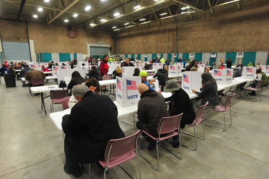 The Cascade County polling center in Exhibition Hall at Montana ExpoPark buzzes with activity on Tuesday evening, November 6.