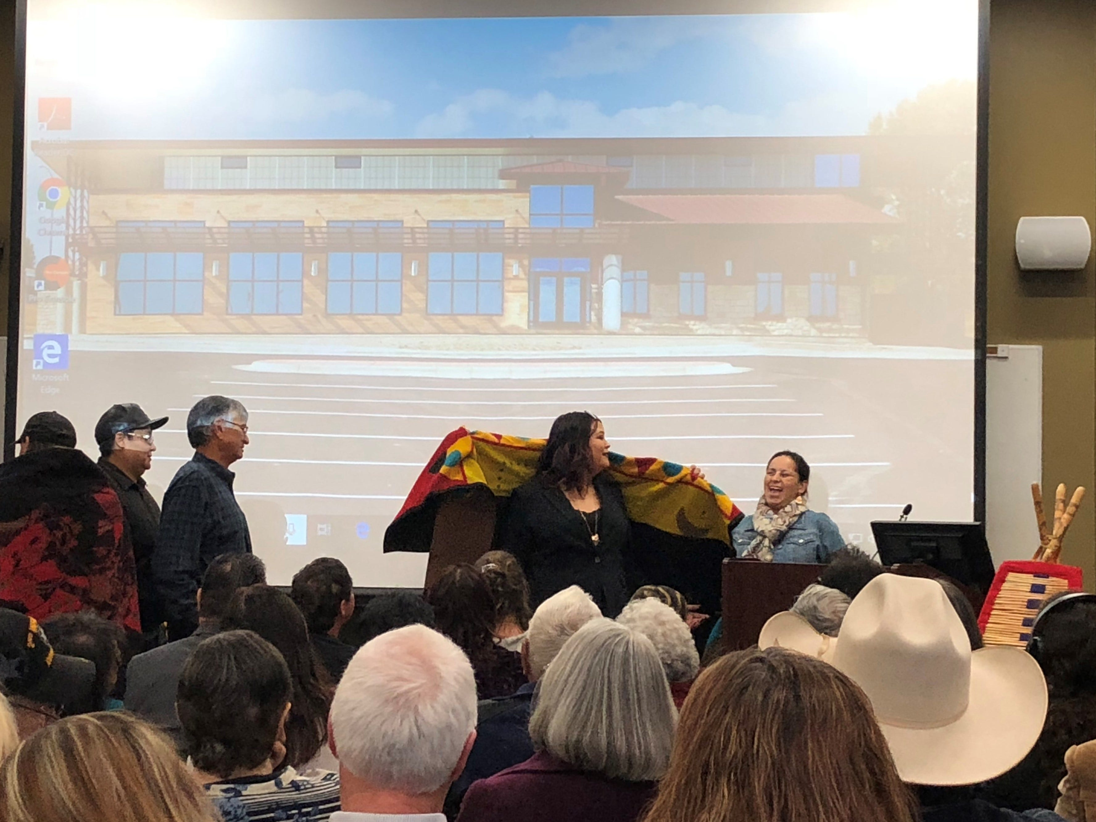 People gather at the Blackfeet Community College to honor Elouise Cobell with the naming of a new building.