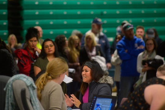Elections workers assist Cascade County residents seeking to vote Tuesday at Exhibition Hall at Montana ExpoPark., Tuesday evening.