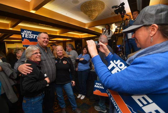 Sen. Jon Tester poses for a photo Tuesday night during his election night party at the Holiday Inn in Great Falls.  Sen. Tester announced his victory Wednesday, Nov. 7, 2018, winning a third term in the U.S. Senate by beating Republican Matt Rosendale.