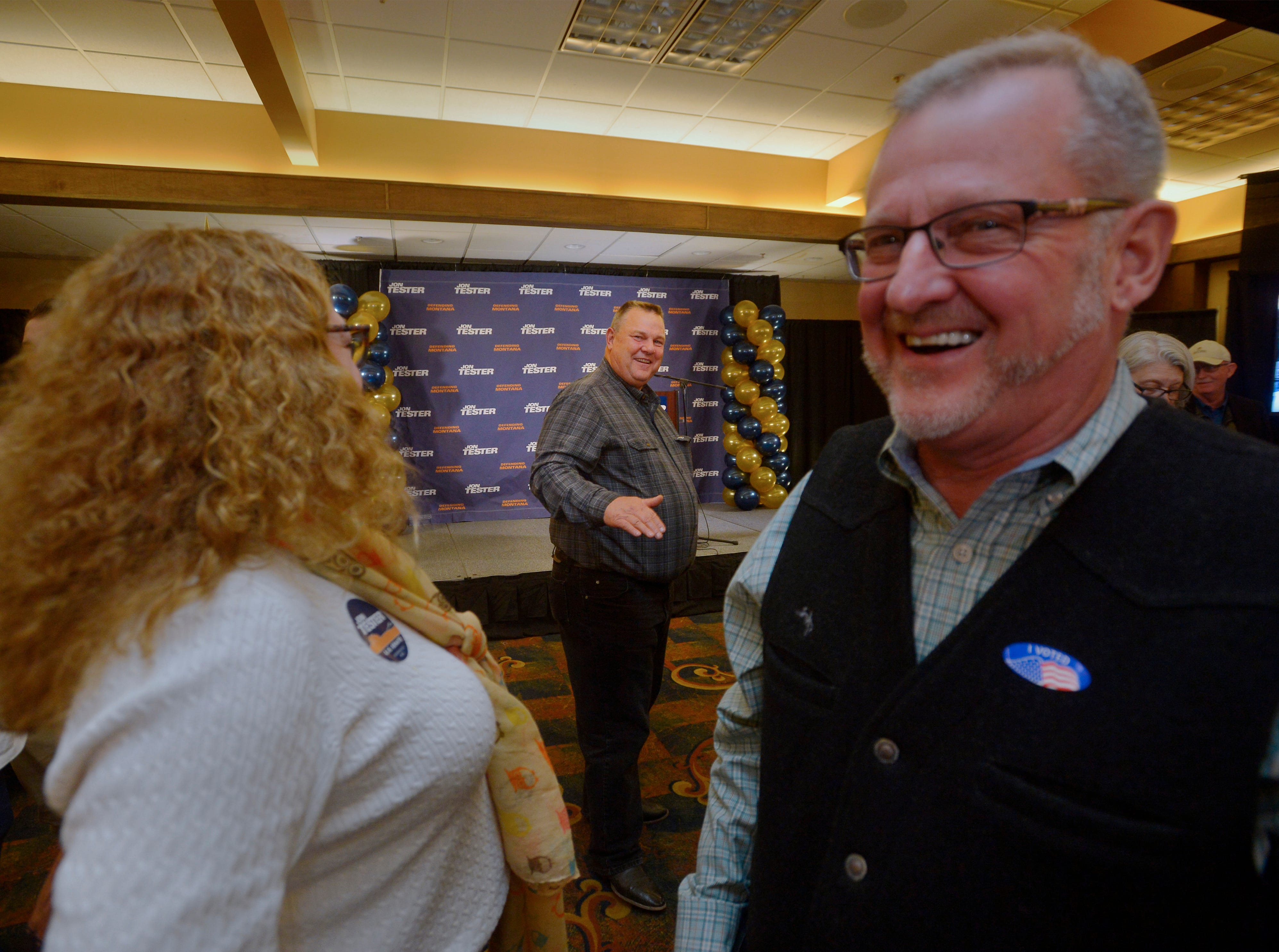 Senator Jon Tester mingles with supporters early in the evening, Tuesday night, during his election night party at the Holiday Inn in Great Falls.