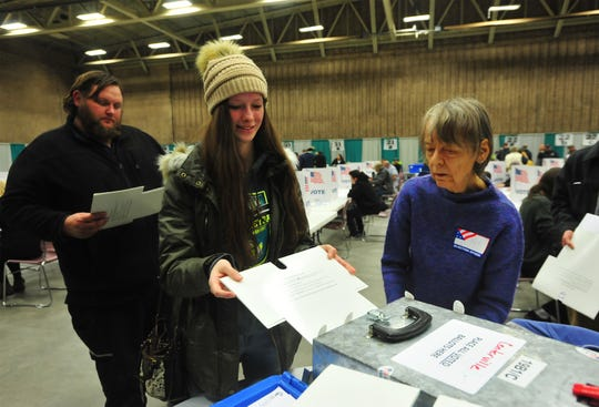 First time voter Smantha Behr, age 18, casts her ballot on Tuesday in Exhibition Hall at Montana ExpoPark.