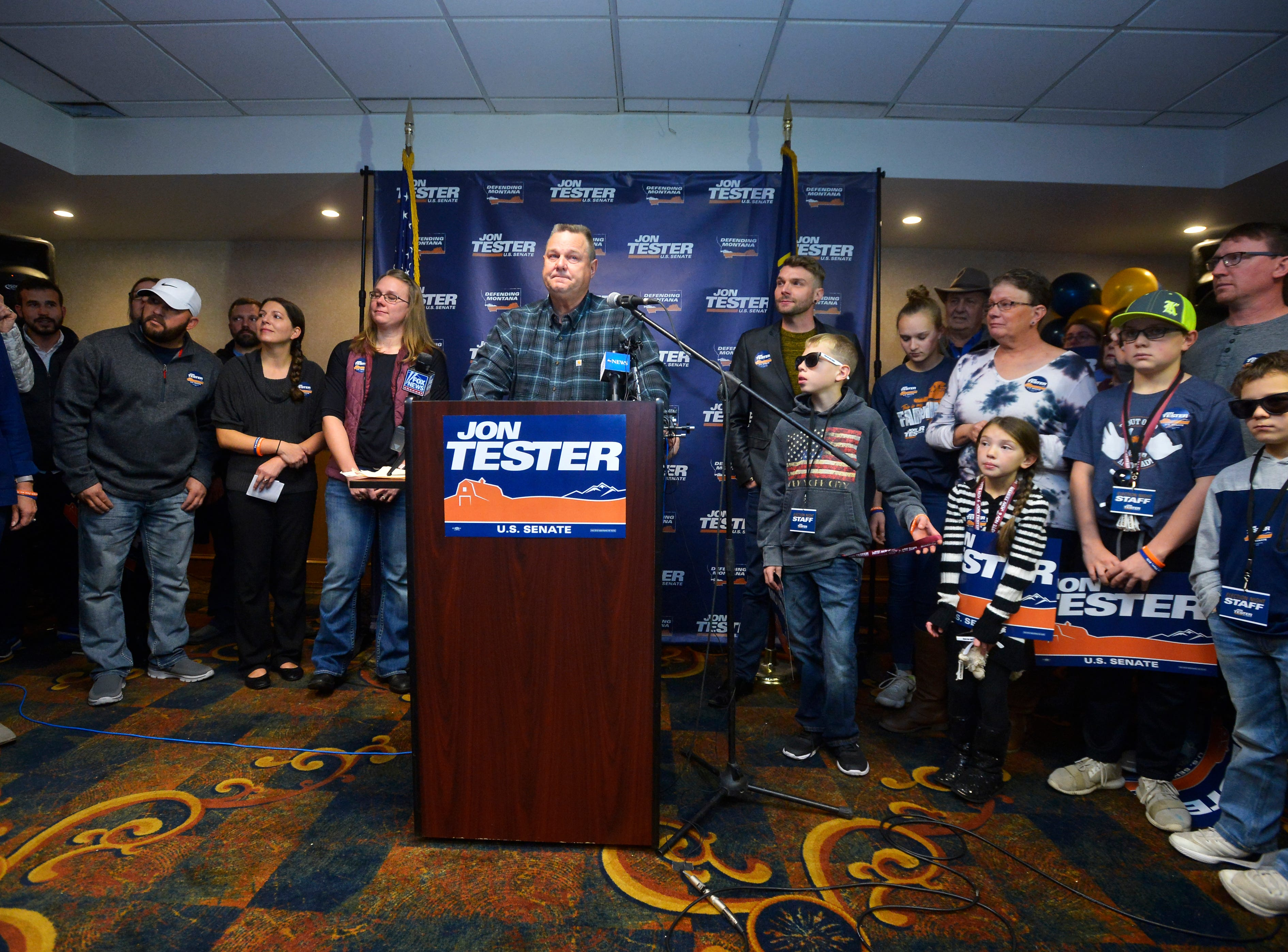 Senator Jon Tester thanks supporters during his victory speech at the Holiday Inn in Great Falls on Wednesday morning.