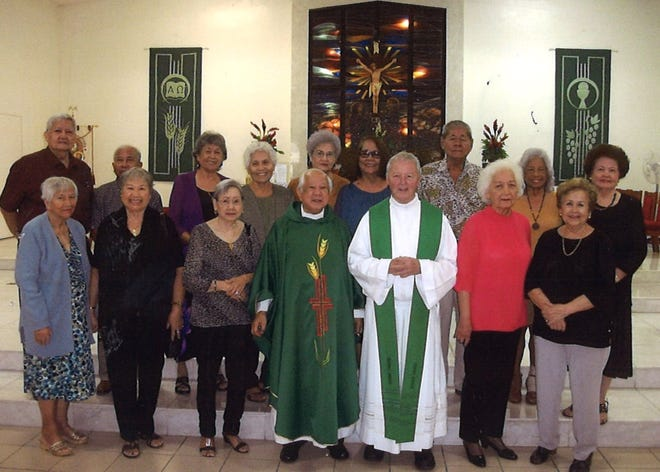 Several members of the Class of 1959 Association are shown following attendance at the Mass at San Juan Bautista Catholic Church in Ordot on August 19. This occasion is a bi-monthly spiritual enhancement of the group. Pictured from left: Cecilia Leon Guerrero, Maria Anderson, Mary Iriarte, Most Rev. Monsignor David A Quitugua, Rev. Father John, Lourdes Santos and Sally Limtiaco. Second row: President John Cruz, Joe Leon Guerrero, Lagrimas Camacho, Isabel Duenas, Mae A. Pellicani, Terry Hara, Bill Hara, Evelyn Bonner and Priscilla Muna.
