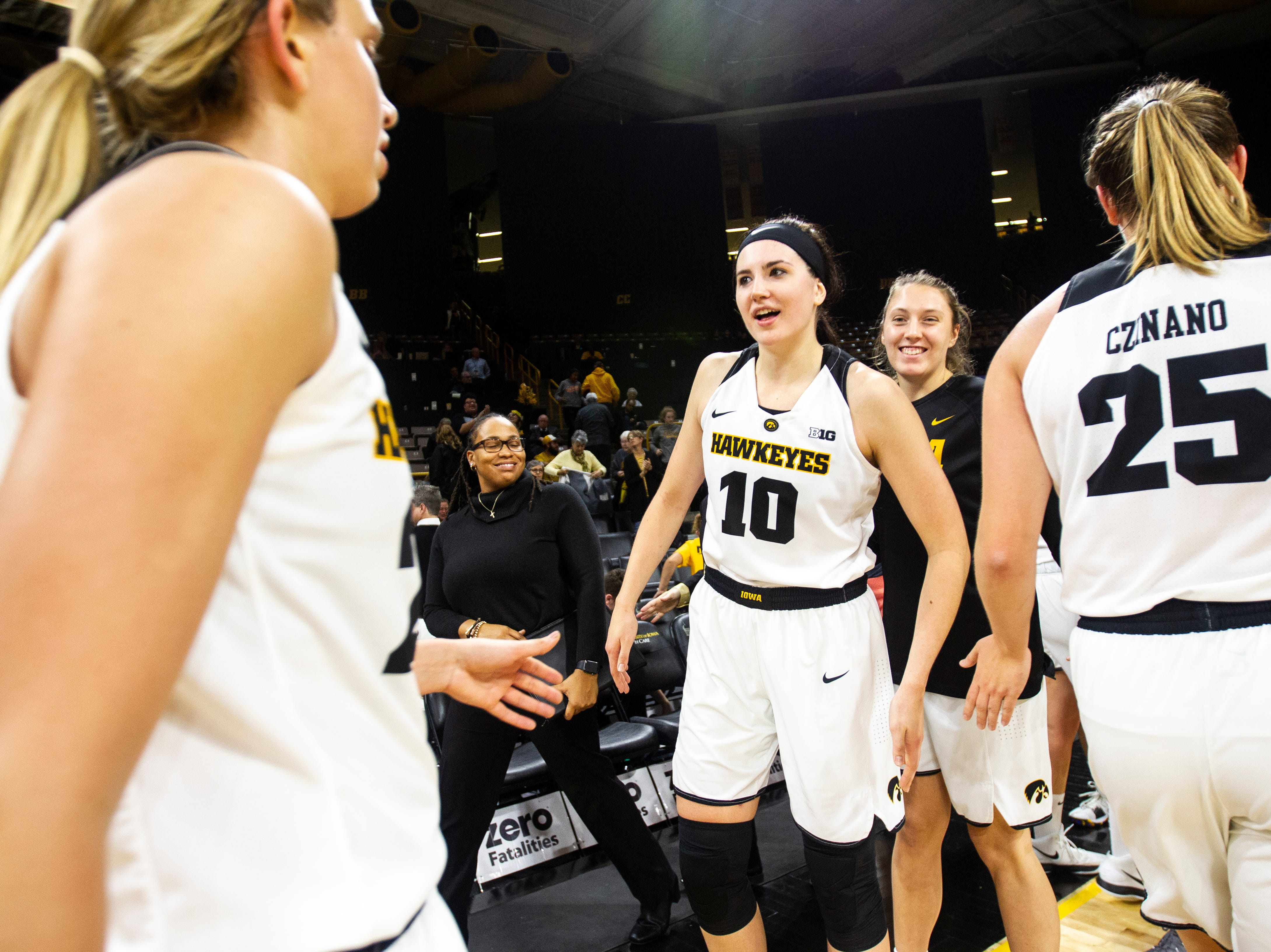 Iowa forward Megan Gustafson (10) celebrates with teammates after a women's basketball exhibition basketball game on Tuesday, Nov. 6, 2018, at Carver-Hawkeye Arena in Iowa City.