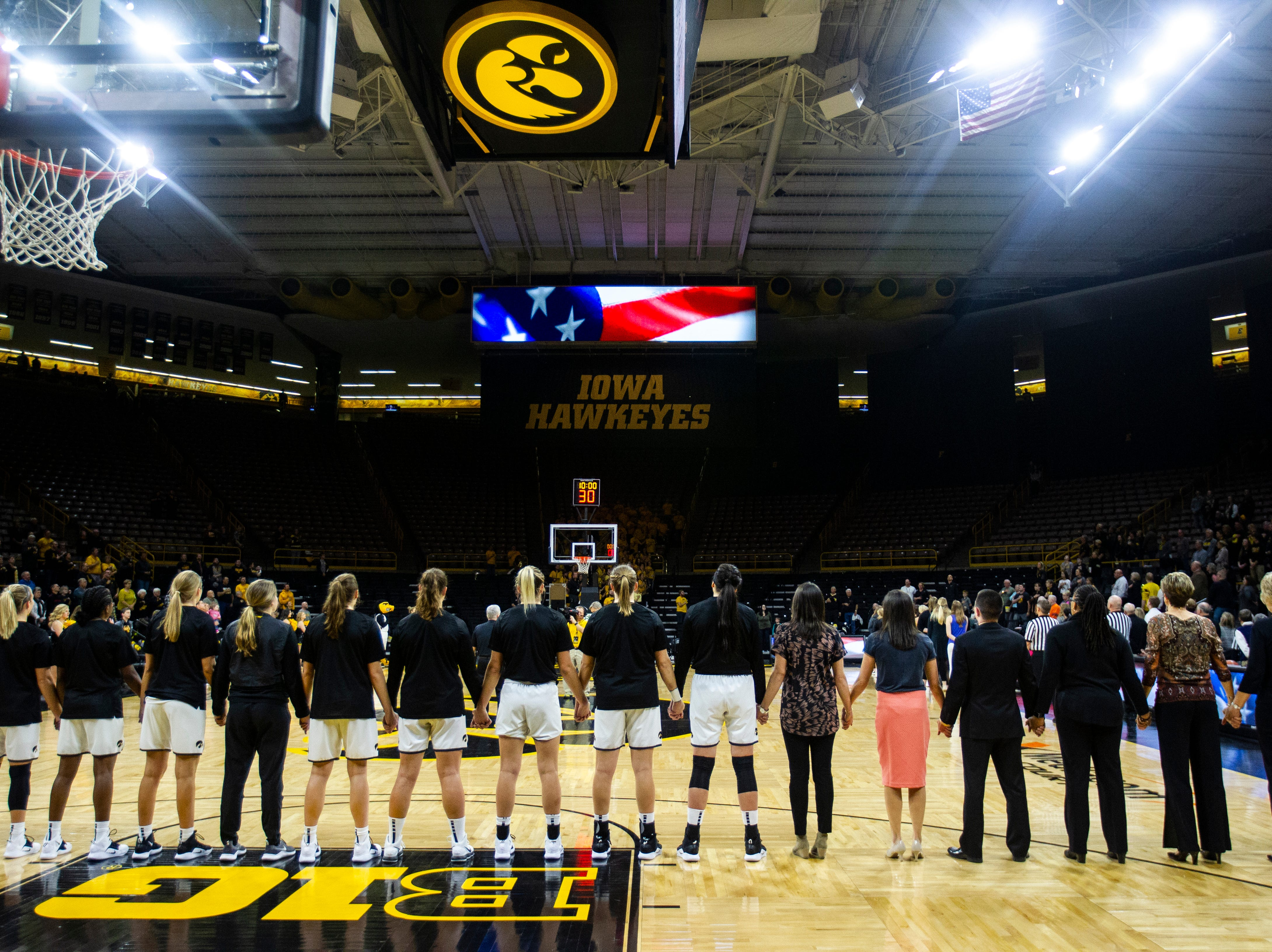 Iowa Hawkeyes line up for the national anthem before a women's basketball exhibition basketball game on Tuesday, Nov. 6, 2018, at Carver-Hawkeye Arena in Iowa City.