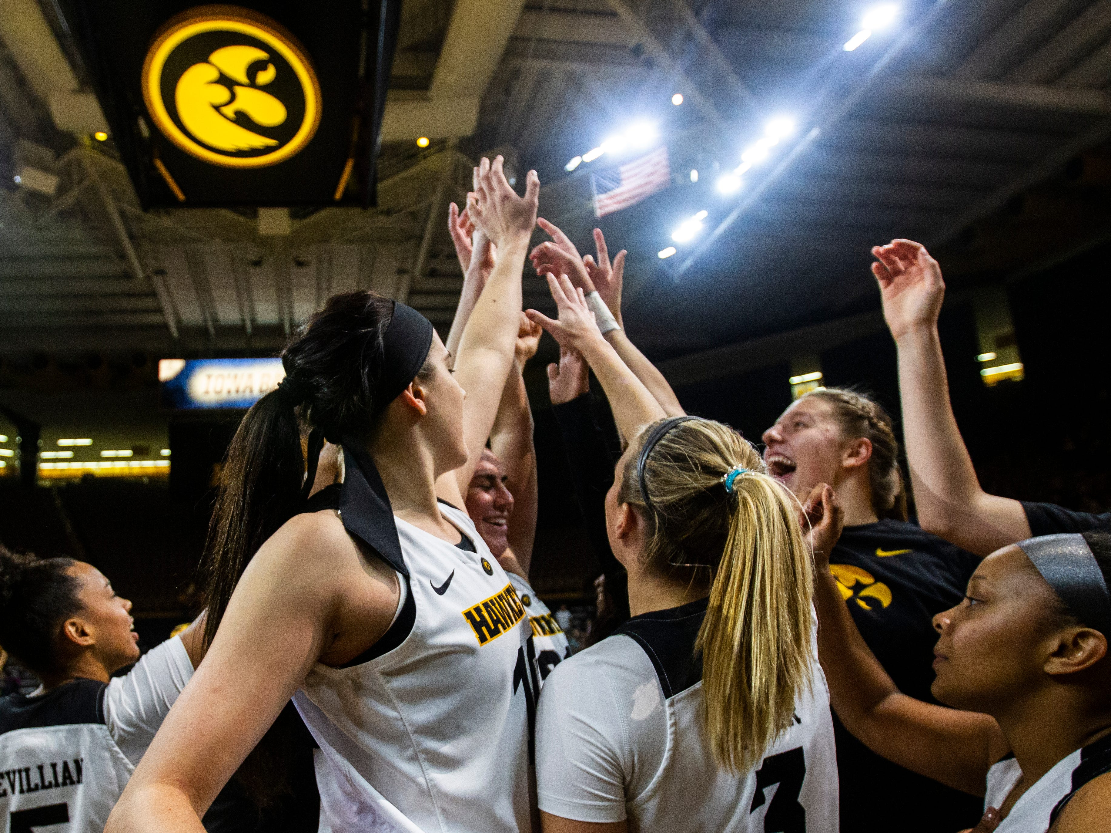 Iowa forward Megan Gustafson (10) huddles up with teammates before a women's basketball exhibition basketball game on Tuesday, Nov. 6, 2018, at Carver-Hawkeye Arena in Iowa City.