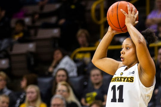 Iowa guard Tania Davis (11) looks to pass during a women's basketball exhibition basketball game on Tuesday, Nov. 6, 2018, at Carver-Hawkeye Arena in Iowa City.