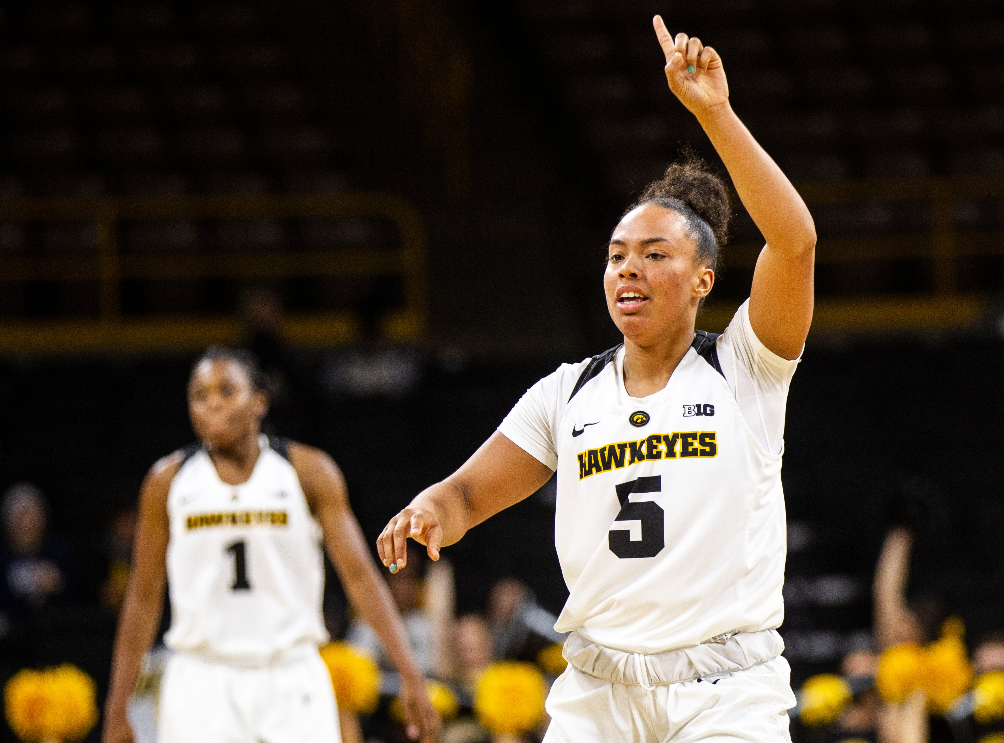 Iowa guard Alexis Sevillian (5) gestures after scoring during a women's basketball exhibition basketball game on Tuesday, Nov. 6, 2018, at Carver-Hawkeye Arena in Iowa City.