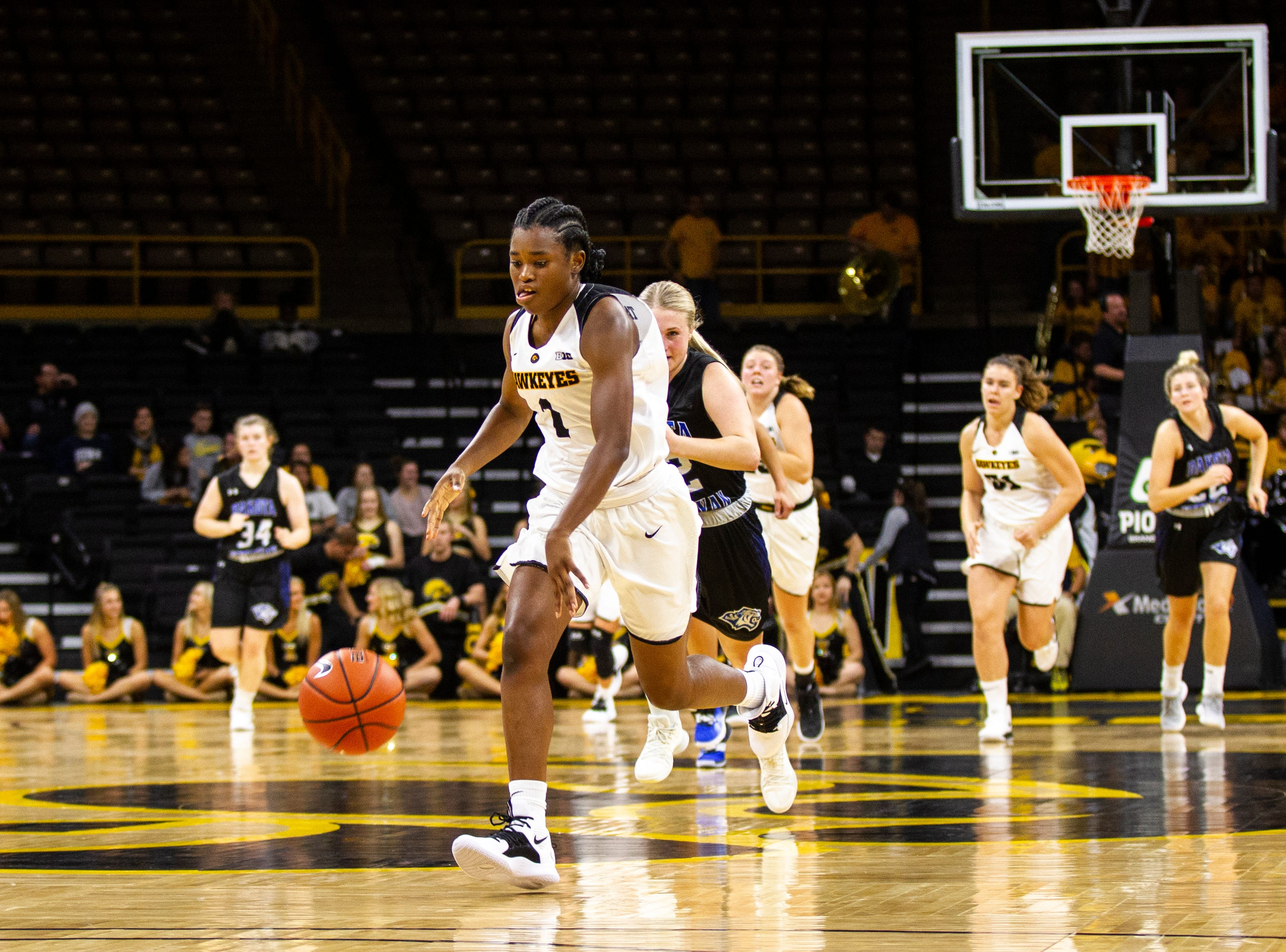 Iowa guard Tomi Taiwo (1) gets a steal during a women's basketball exhibition basketball game on Tuesday, Nov. 6, 2018, at Carver-Hawkeye Arena in Iowa City.