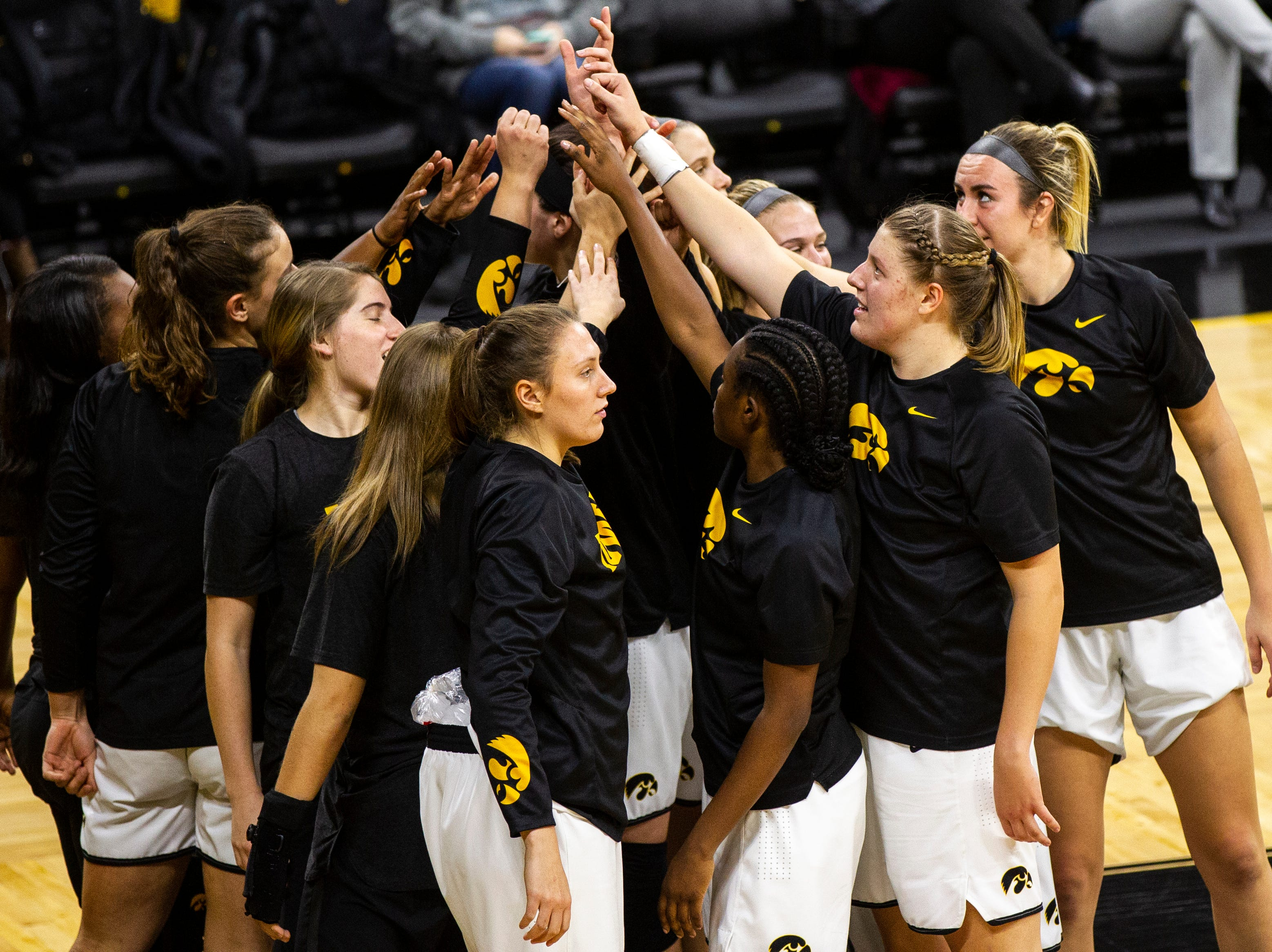 Iowa Hawkeyes players huddle up during a women's basketball exhibition basketball game on Tuesday, Nov. 6, 2018, at Carver-Hawkeye Arena in Iowa City.