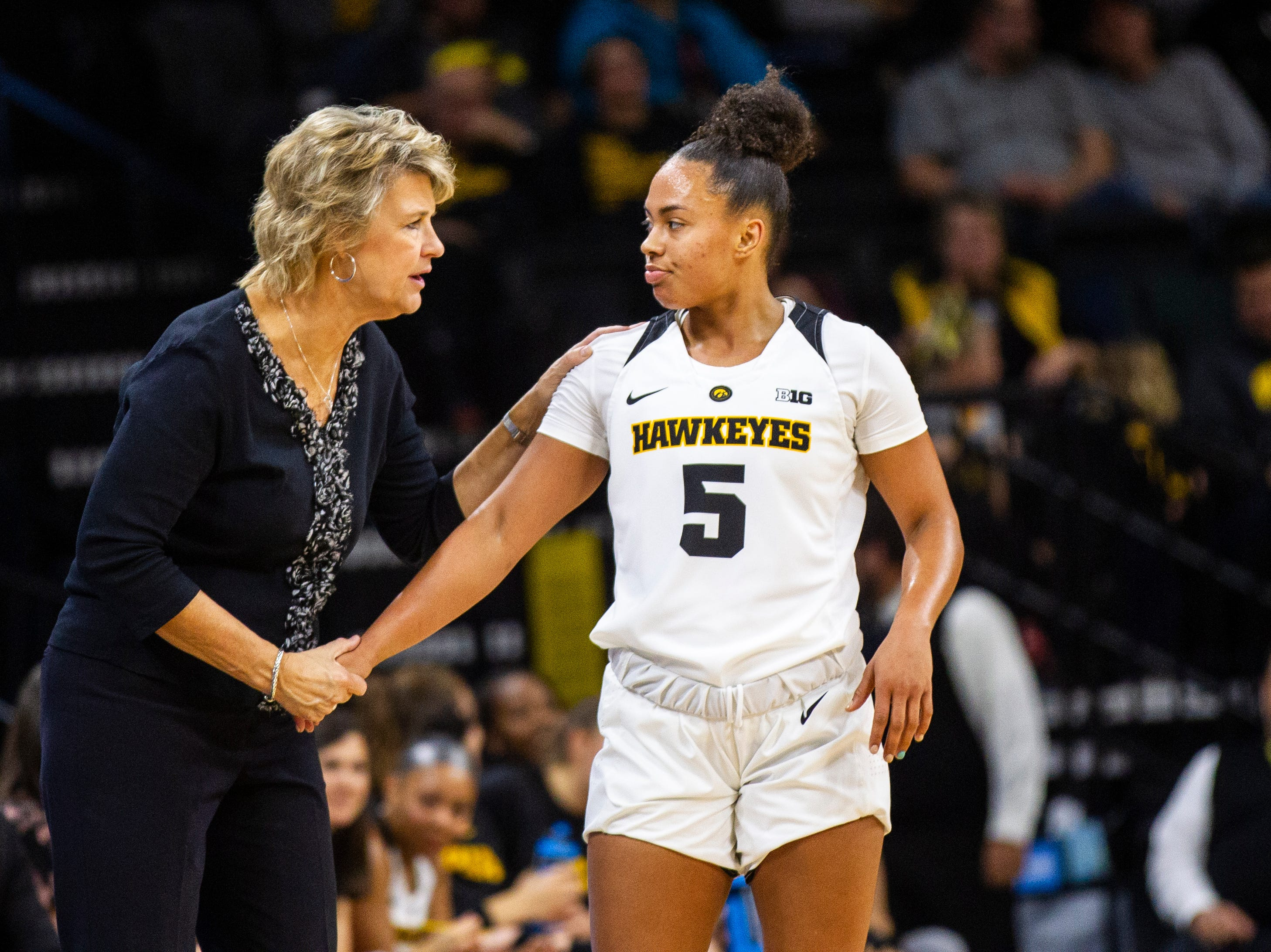 Iowa head coach Lisa Bluder talks with Iowa guard Alexis Sevillian (5) during a women's basketball exhibition basketball game on Tuesday, Nov. 6, 2018, at Carver-Hawkeye Arena in Iowa City.
