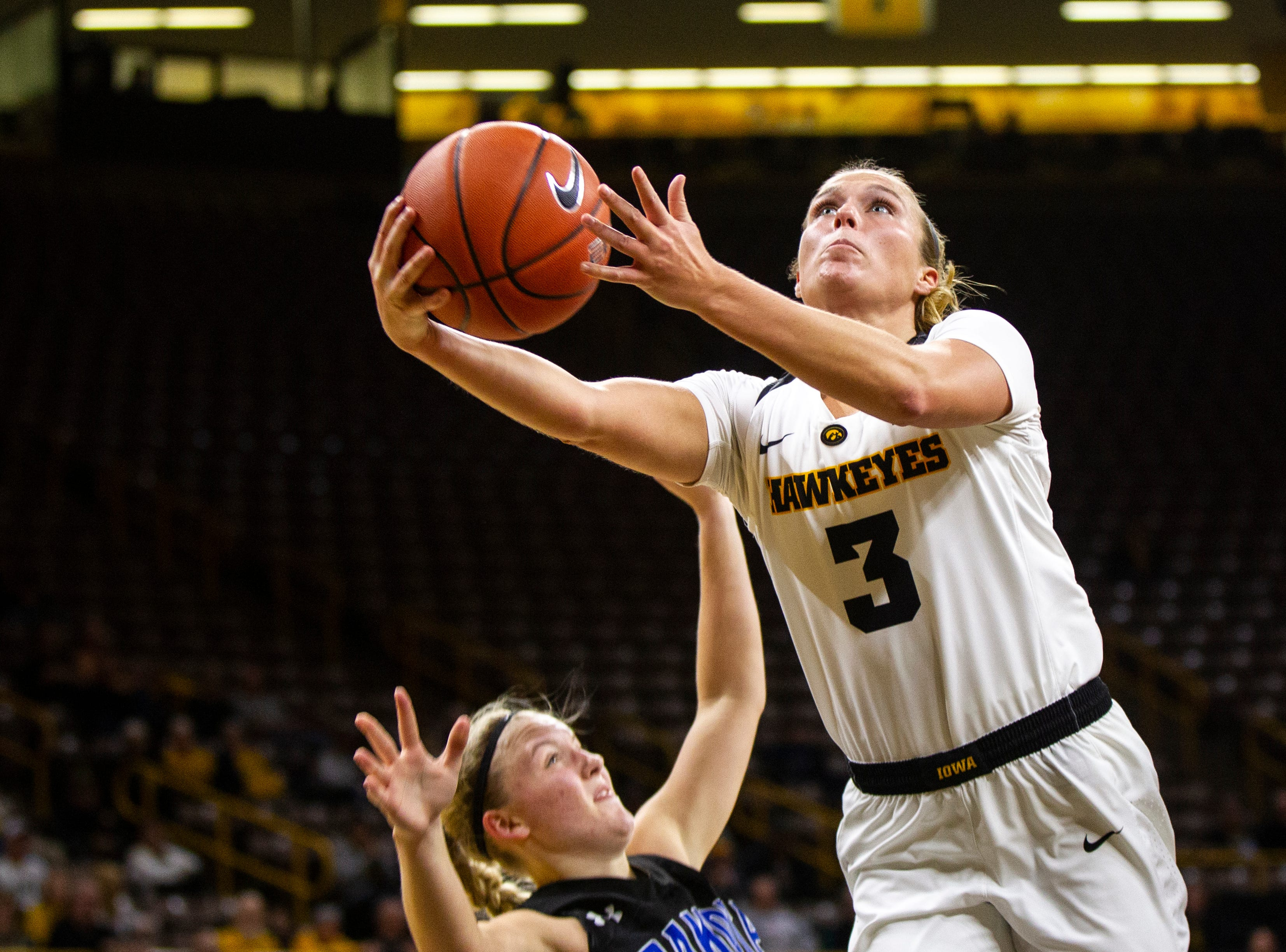 Iowa guard Makenzie Meyer (3) attempts a layup during a women's basketball exhibition basketball game on Tuesday, Nov. 6, 2018, at Carver-Hawkeye Arena in Iowa City.