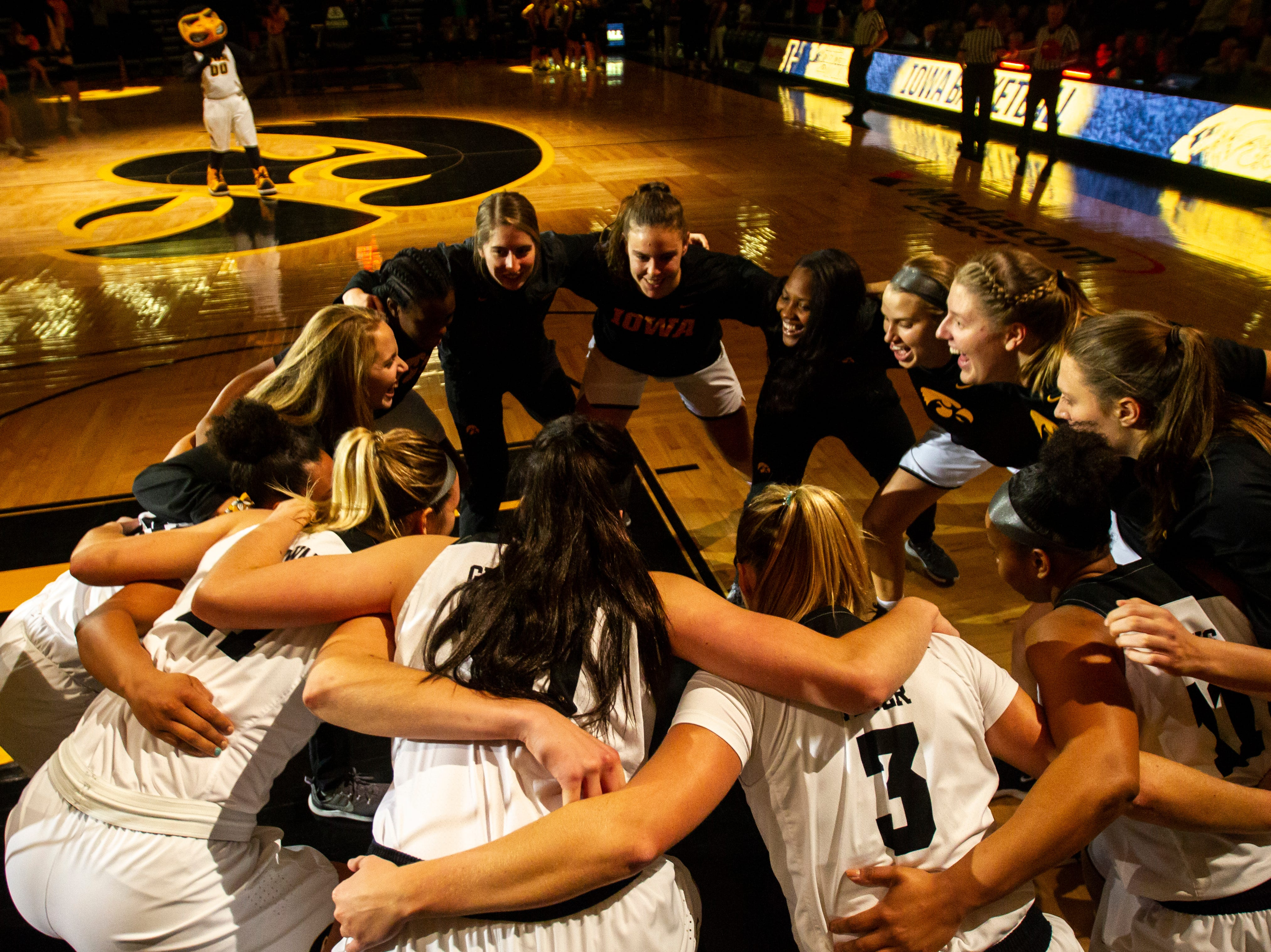 Iowa Hawkeyes players huddle before a women's basketball exhibition basketball game on Tuesday, Nov. 6, 2018, at Carver-Hawkeye Arena in Iowa City.