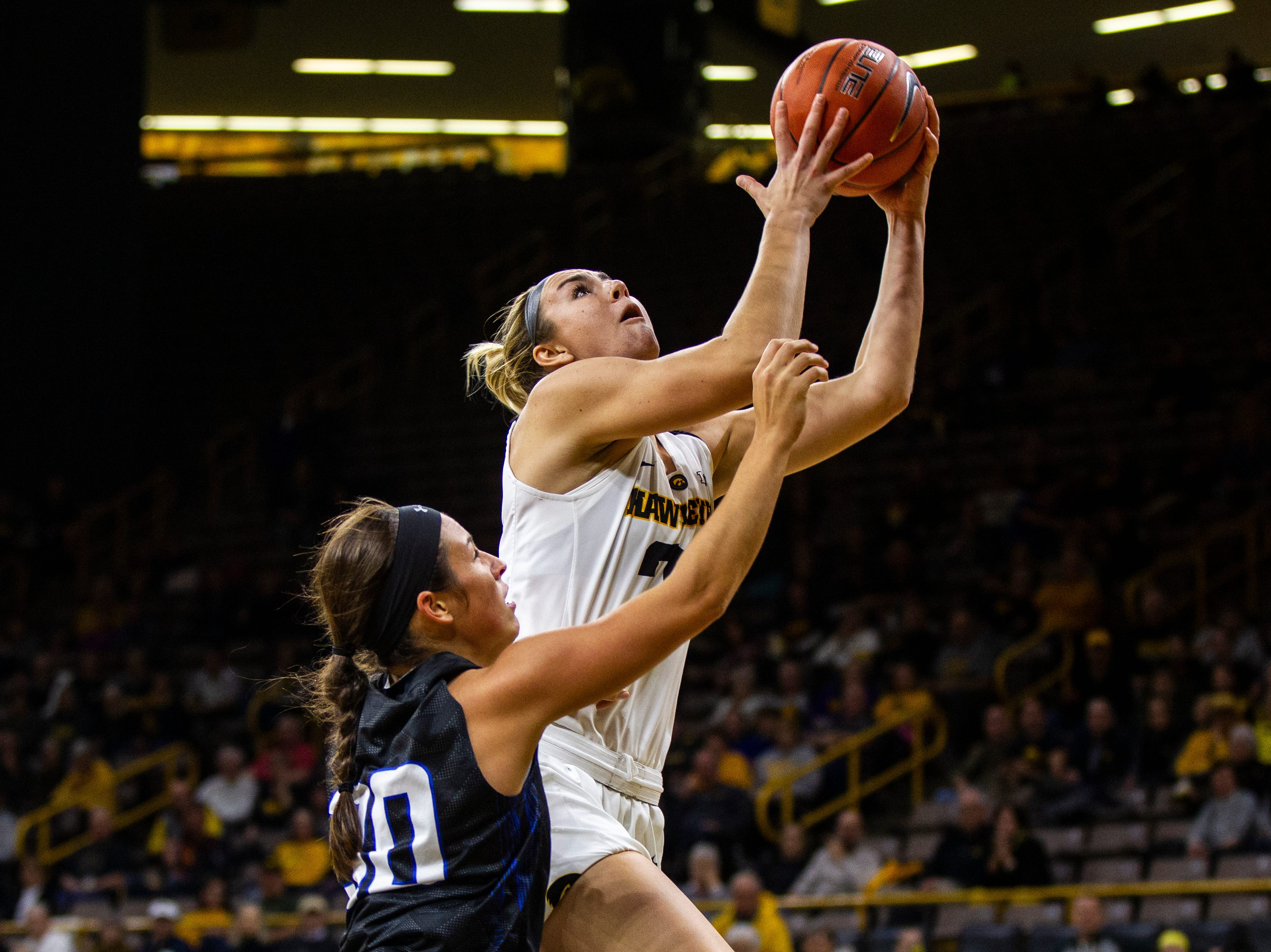 Iowa forward Hannah Stewart (21) attempts a layup during a women's basketball exhibition basketball game on Tuesday, Nov. 6, 2018, at Carver-Hawkeye Arena in Iowa City.