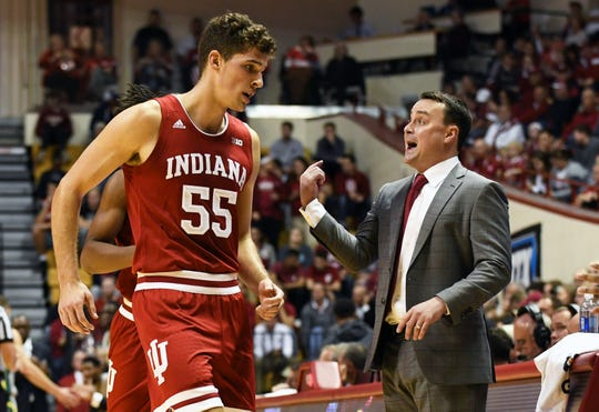 Indiana Hoosiers forward Evan Fitzner (55) talks to head coach Archie Miller during the game against Chicago State at Simon Skjodt Assembly Hall in Bloomington, Ind., on Tuesday, Nov. 6, 2018.