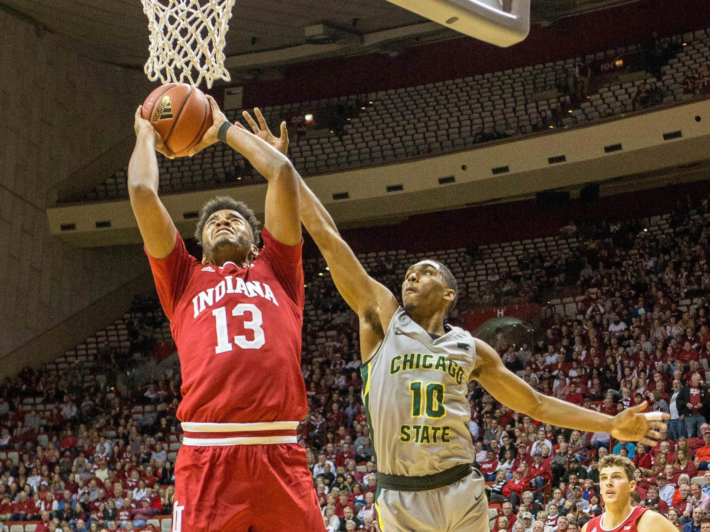 Indiana Hoosiers forward Juwan Morgan (13) shoots the ball while Chicago State Cougars guard Anthony Harris (10) defends in the first half at Assembly Hall.