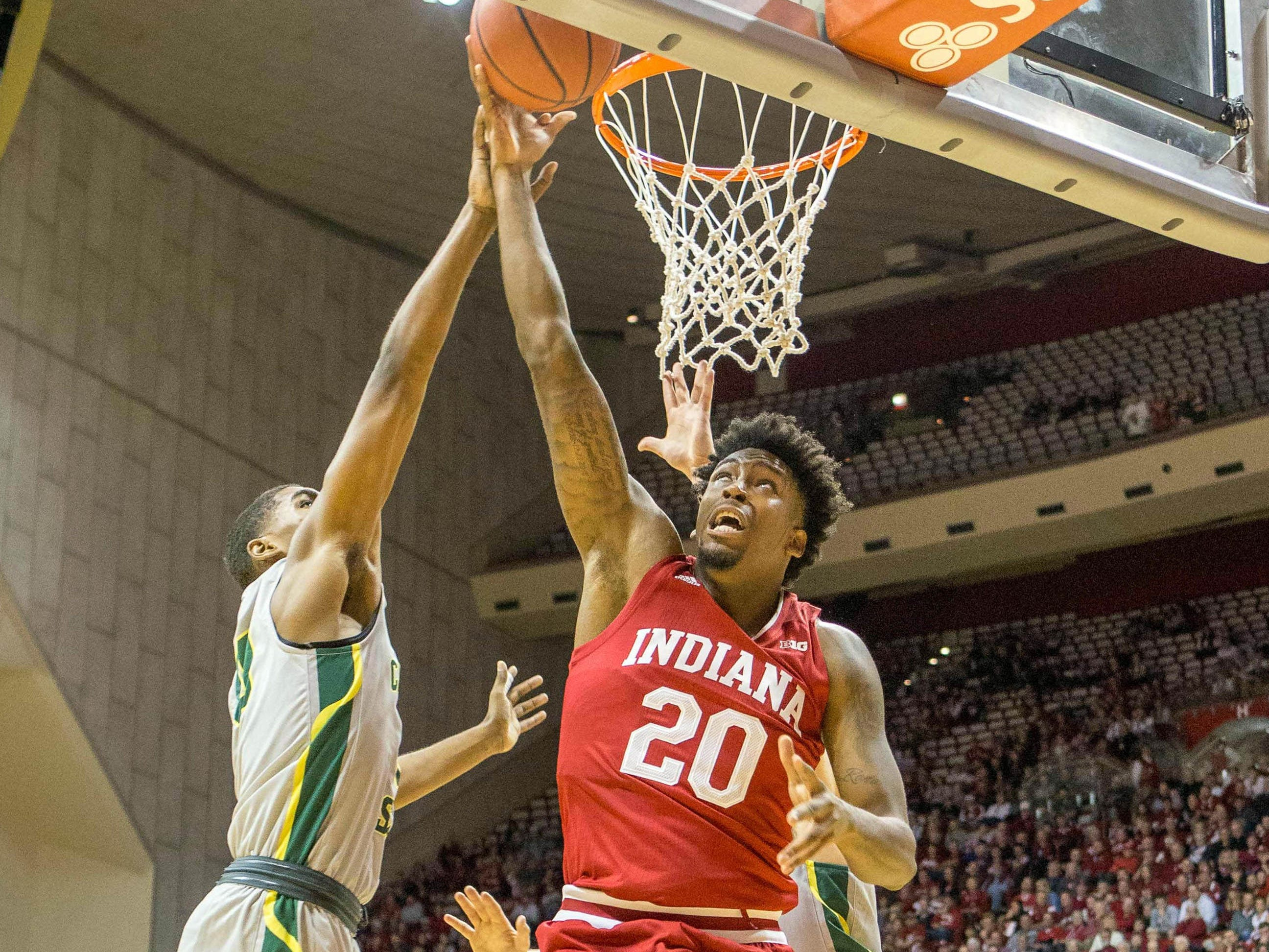 ; Indiana Hoosiers forward De'Ron Davis (20) shoots the ball while Chicago State Cougars guard Travon Bell (3) defends in the first half at Assembly Hall.