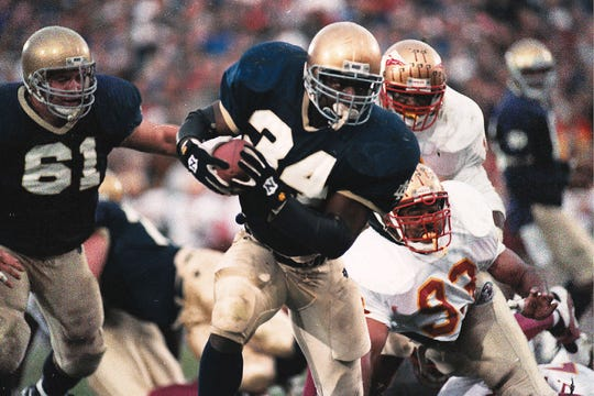Notre Dame back Ray Zellars (34) headed upfield against Florida State.