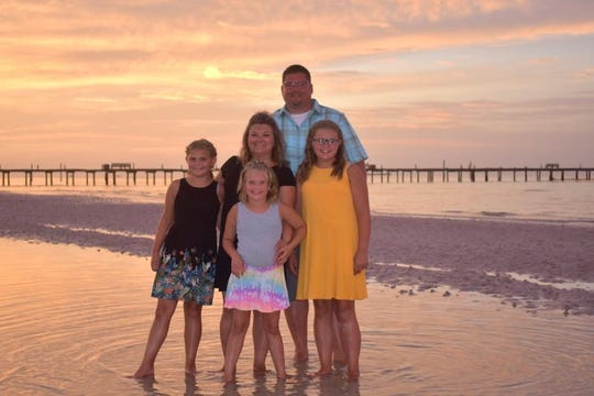 Andy Williams is shown with his wife, Michelle, and daughters (from left) Karsynn, Presleigh and Skylar.