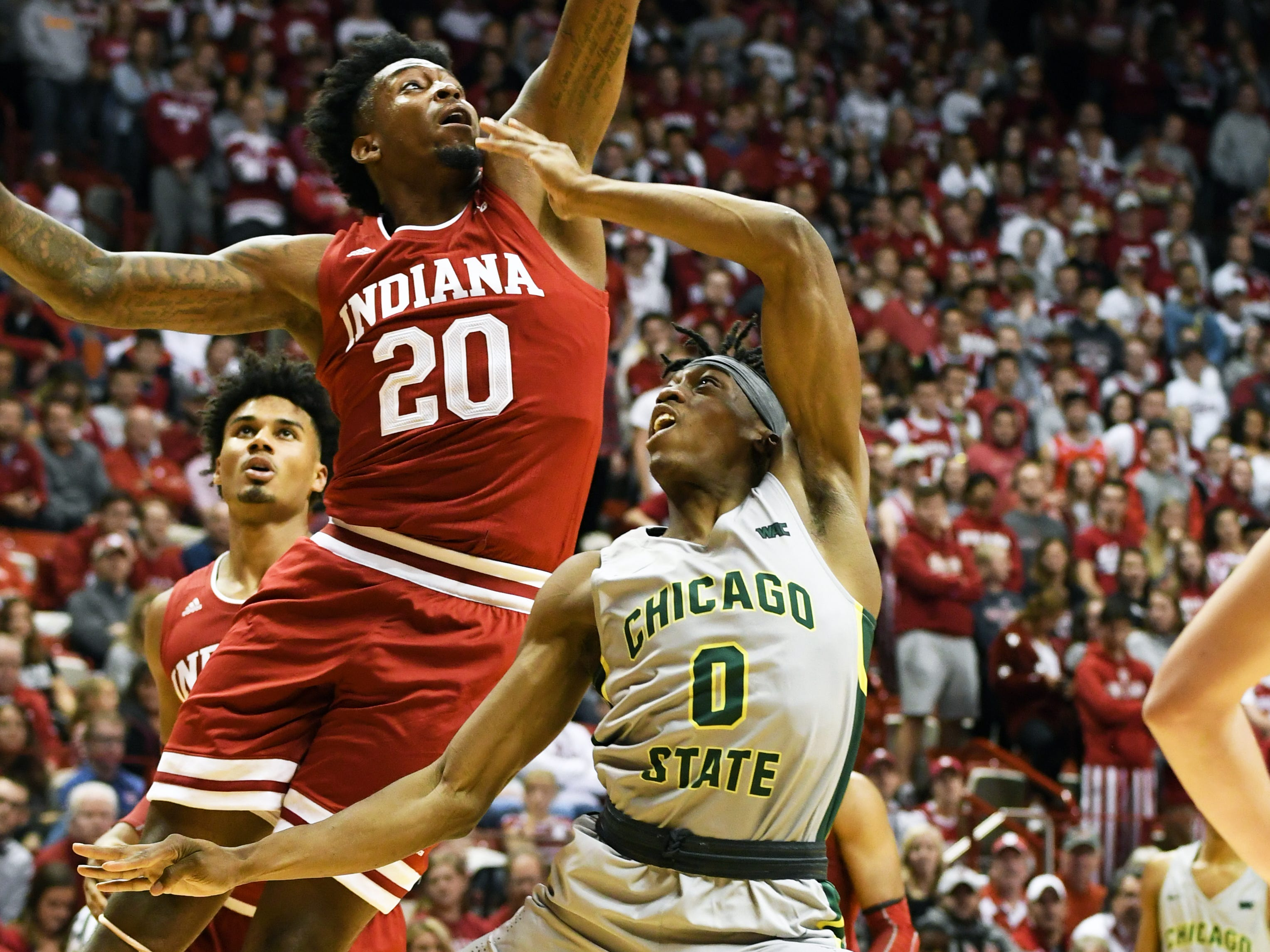 Indiana Hoosiers forward De'Ron Davis (20) blocks a shot from Chicago State forward Ken Odiase (0) during the game against Chicago State at Simon Skjodt Assembly Hall in Bloomington, Ind., on Tuesday, Nov. 6, 2018.