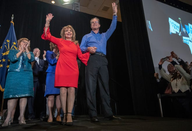 Mike Braun (right), waves alongside his wife Maureen Braun, as he prepares to give his acceptance speech, GOP election night event at the JW Marriott, Indianapolis, Tuesday, Nov. 6, 2018.