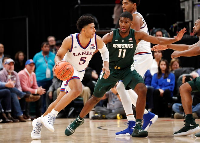 Nov 6, 2018; Indianapolis, IN, USA; Kansas Jayhawks guard Quentin Grimes (5) drives to the basket against  Michigan State Spartans forward Aaron Henry (11) in the second half during the Champions Classic at Bankers Life Fieldhouse. Mandatory Credit: Brian Spurlock-USA TODAY Sports