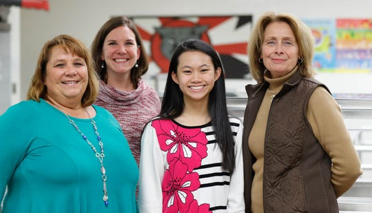 Left to right, Supervisor of Child Nutrition, Annette Guenther, Social Studies Teacher, Annie Craig, North Central High School student, Grace Lee, and Assistant Supervisor of Child Nutrition, Christine Stoner, stand in the kitchen at North Central High School in Indianapolis on Wednesday, Nov. 7, 2018. The school staffers worked with Lee  to identify school foods which contain artificial dye after Lee developed carpal tunnel at an oddly young age, possibly due to eating yellow dye. Alternative medicine has linked artificial coloring to the wrist pain in people who have an allergy.