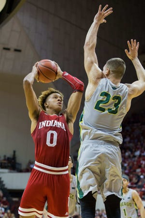 Indiana Hoosiers guard Romeo Langford (0) shoots the ball while Chicago State Cougars forward Patrick Szpir (23) defends in the first half at Assembly Hall.