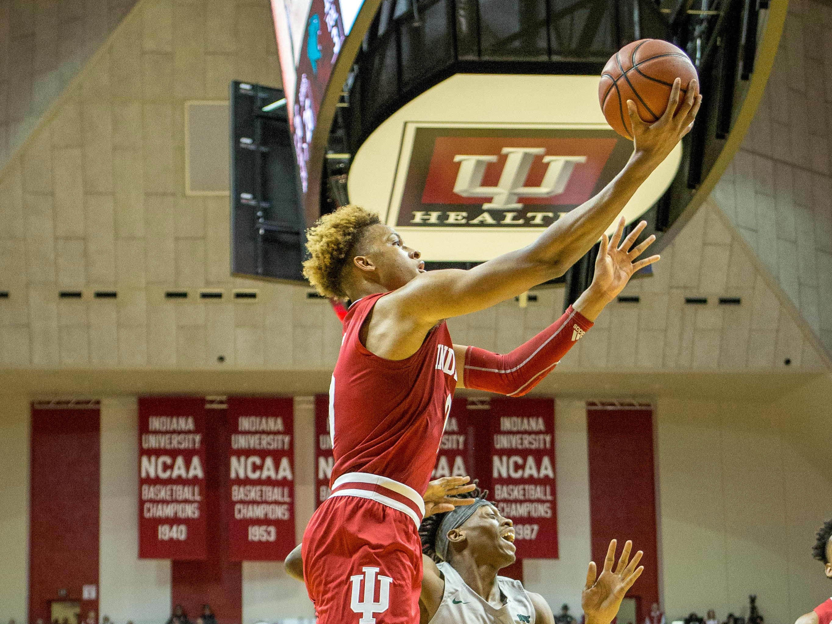 Indiana Hoosiers guard Romeo Langford (0) shoots the ball and is fouled by Chicago State Cougars forward Ken Odiase (0) in the first half at Assembly Hall.