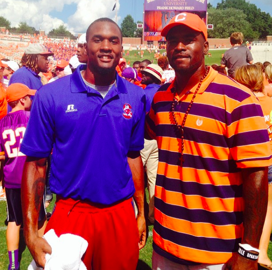 Darius Leonard (left) and older brother Anthony Waters on the field at Clemson, Darius' dream school.