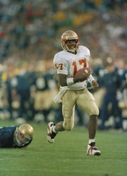 Florida State quarterback Charlie Ward runs free. He would win the Heisman Trophy that year.