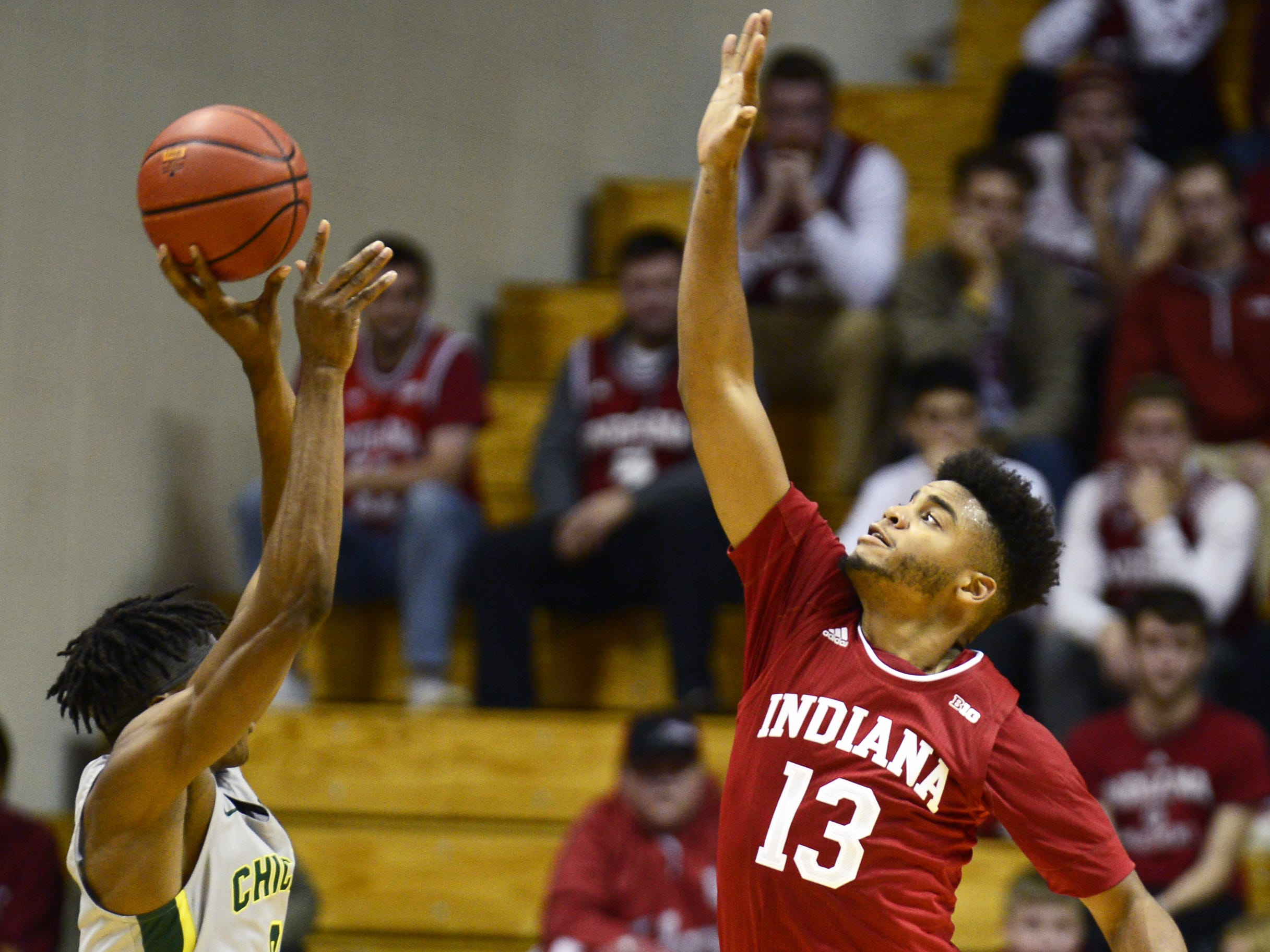 Indiana Hoosiers forward Juwan Morgan (13) contests a shot during the game against Chicago State at Simon Skjodt Assembly Hall in Bloomington, Ind., on Tuesday, Nov. 6, 2018.