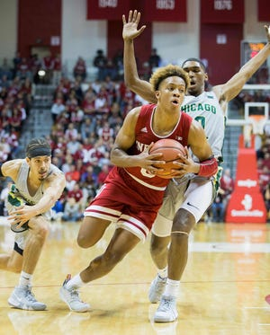 Indiana Hoosiers guard Romeo Langford (0) pulls up his dribble to shoot as he passes Chicago State Cougars guard Rob Shaw (1) and guard Anthony Harris (10) in the first half at Assembly Hall.