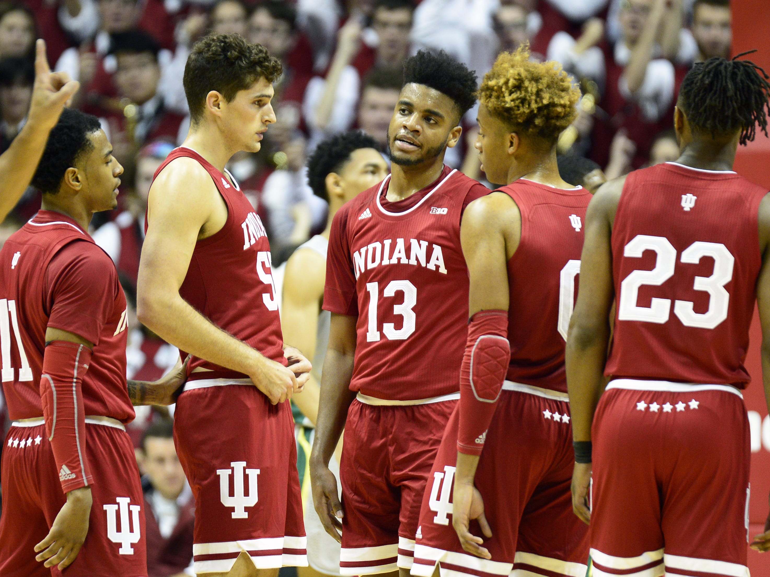 Juwan Morgan (13) and IU basketball teammates gather during action against Chicago State on Nov. 6, 2018.