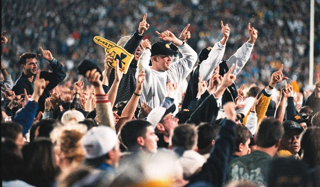 Notre Dame fans celebrated after a victory over Florida State in South Bend, Ind., on Nov. 13, 1993. Twenty-five years later the victory is still celebrated, but losing out to Florida State for the national title still burns.