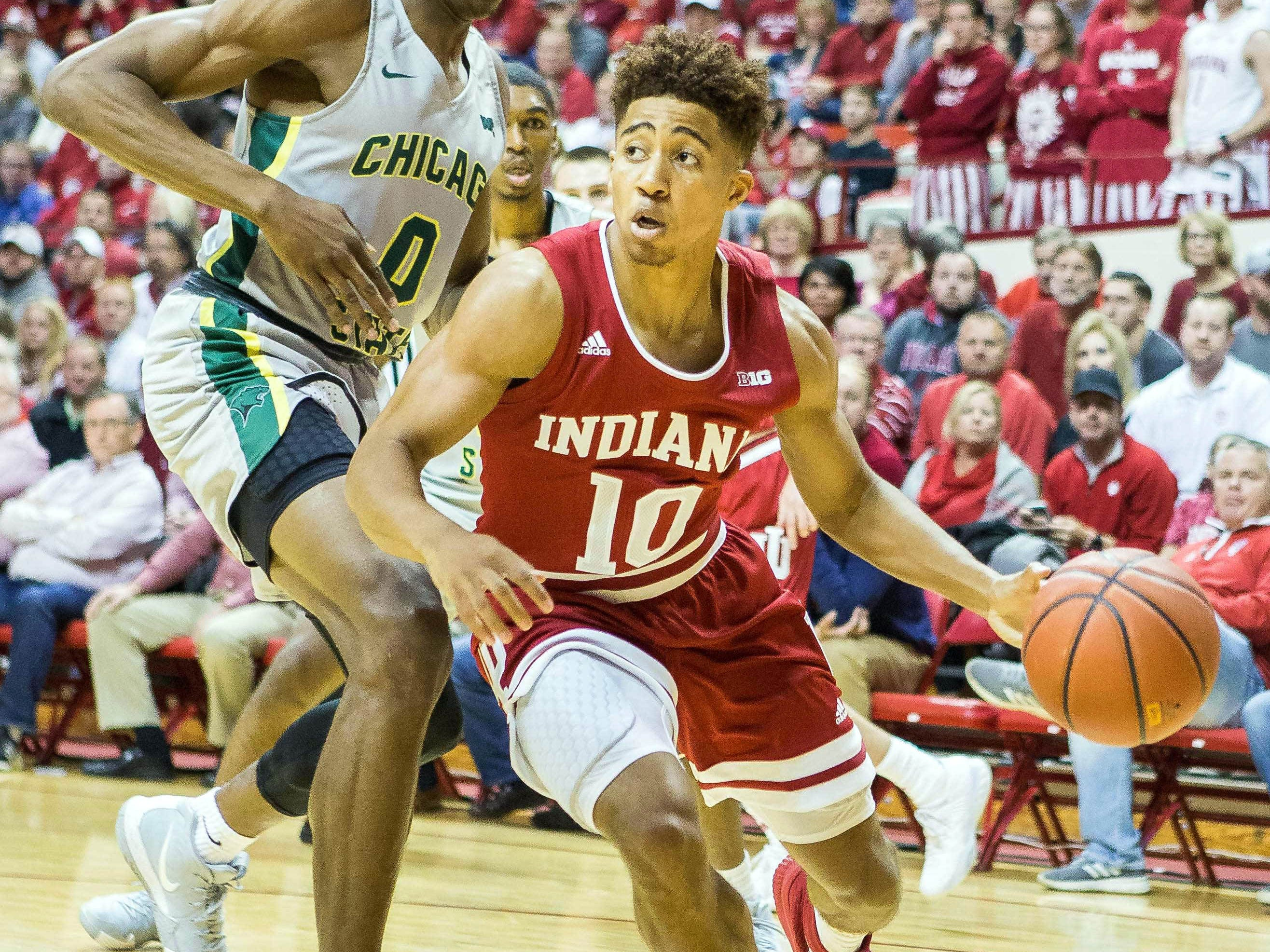 Indiana Hoosiers guard Rob Phinisee (10) dribbles the ball while Chicago State Cougars forward Ken Odiase (0) defends in the first half at Assembly Hall.